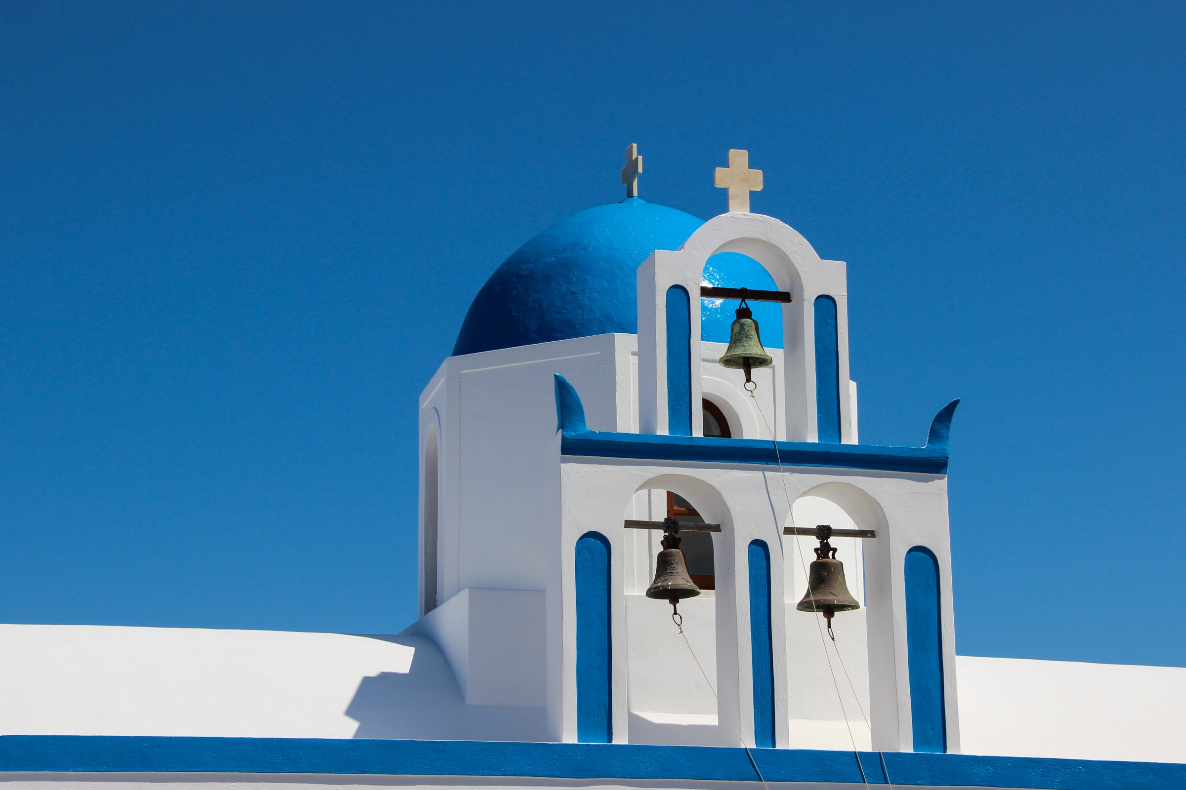 Church Bell Gable And Dome In Santorini Island
