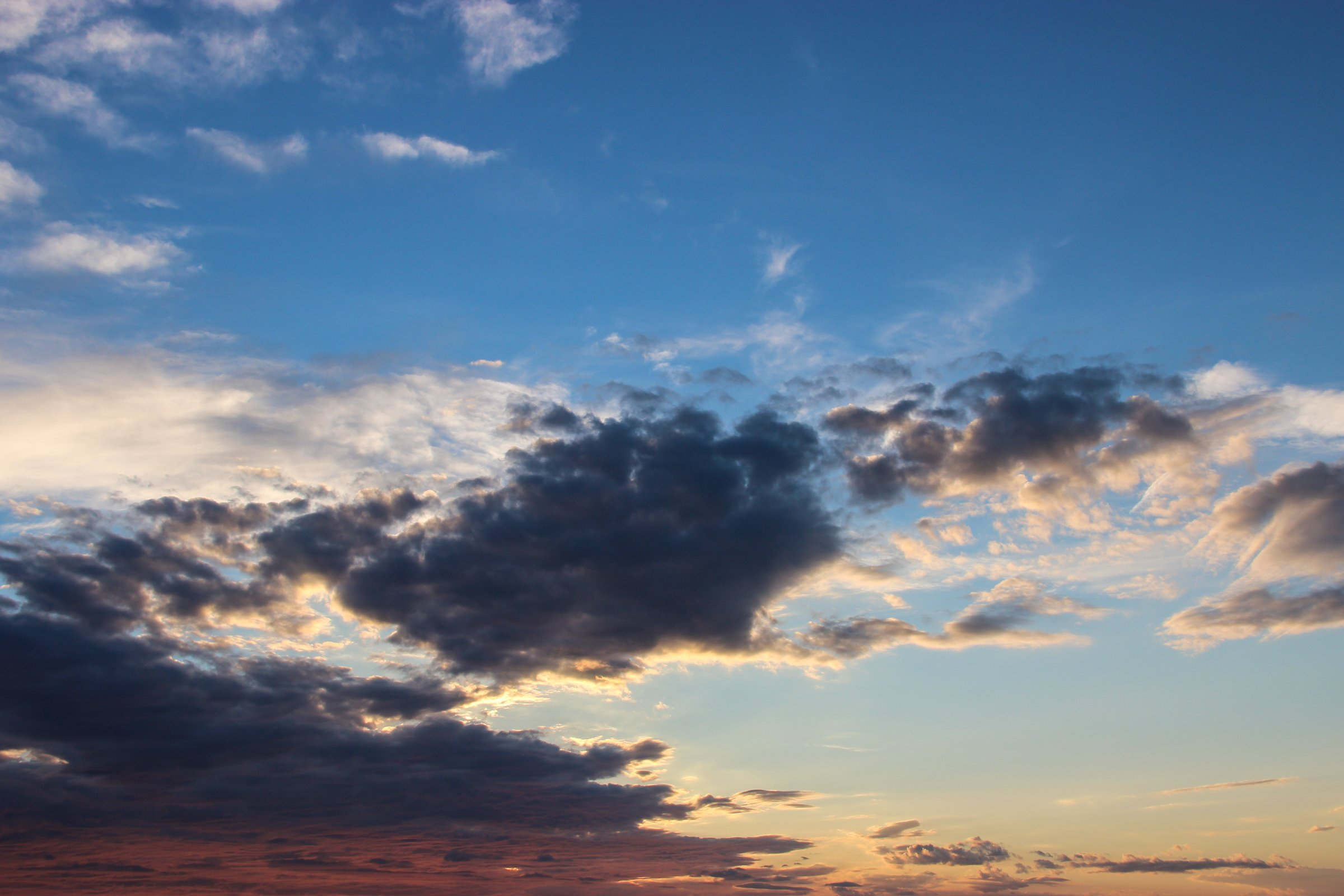Scattered Shadowed Clouds In Sky During Sunset