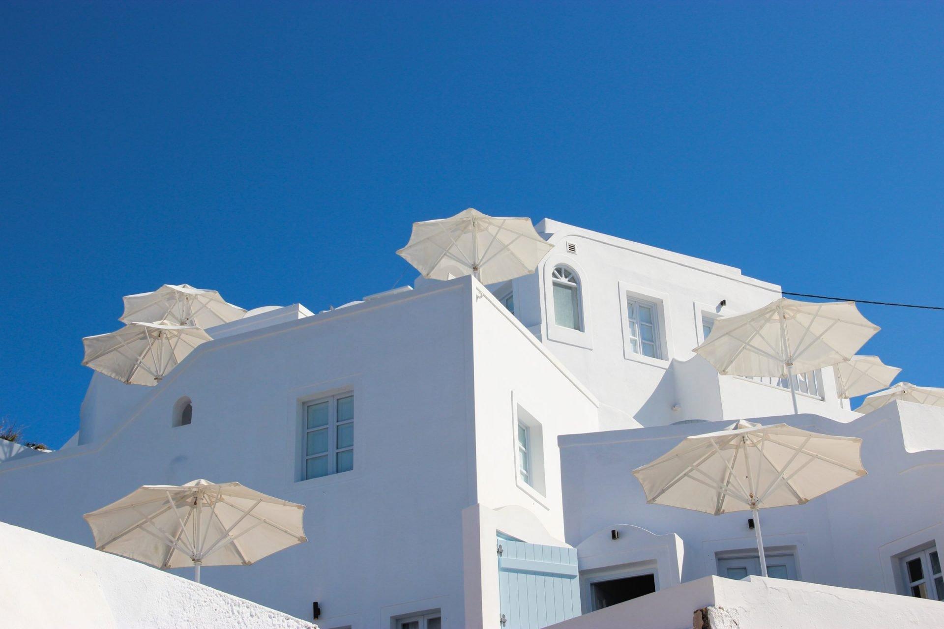 White Terrace Umbrellas In White Building