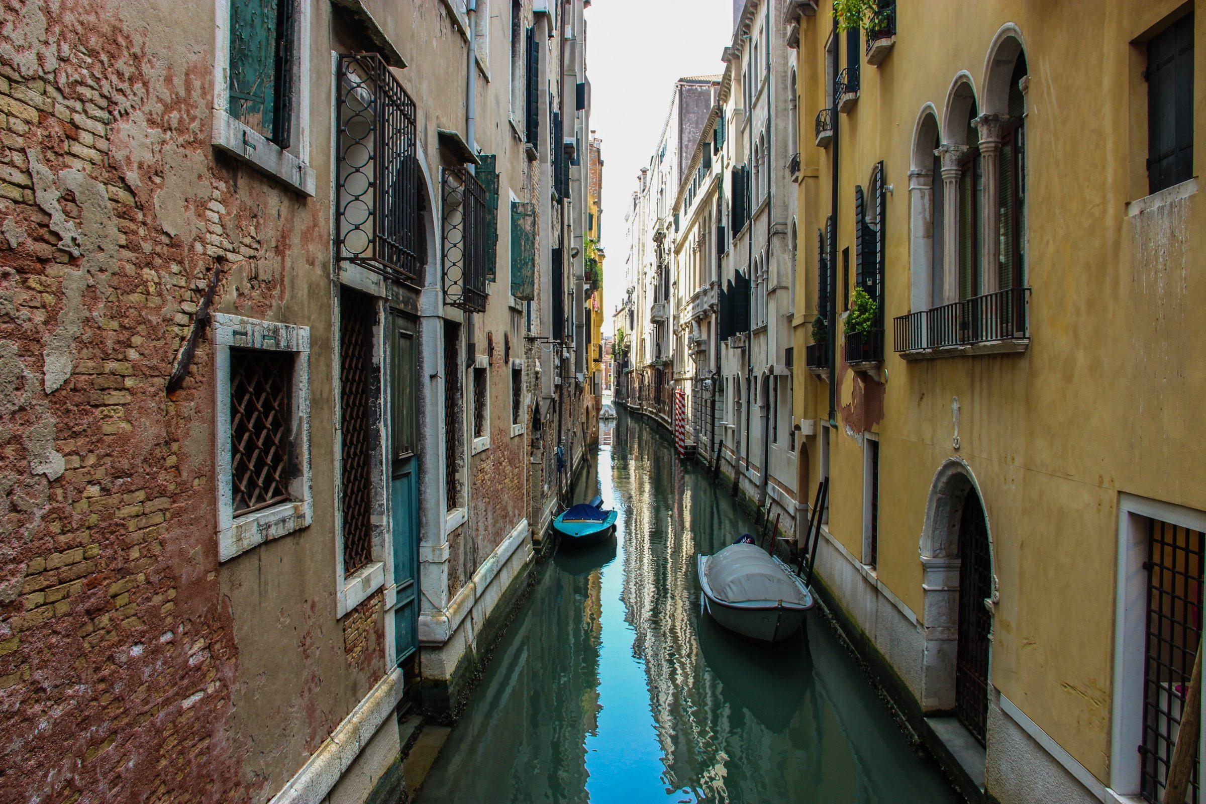 Boats Between Buildings In Narrow Canal