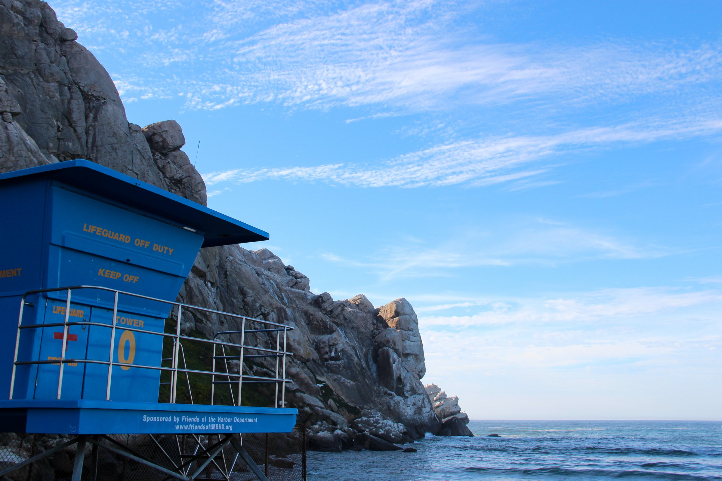 Lifeguard Tower Near Rocky Cliff