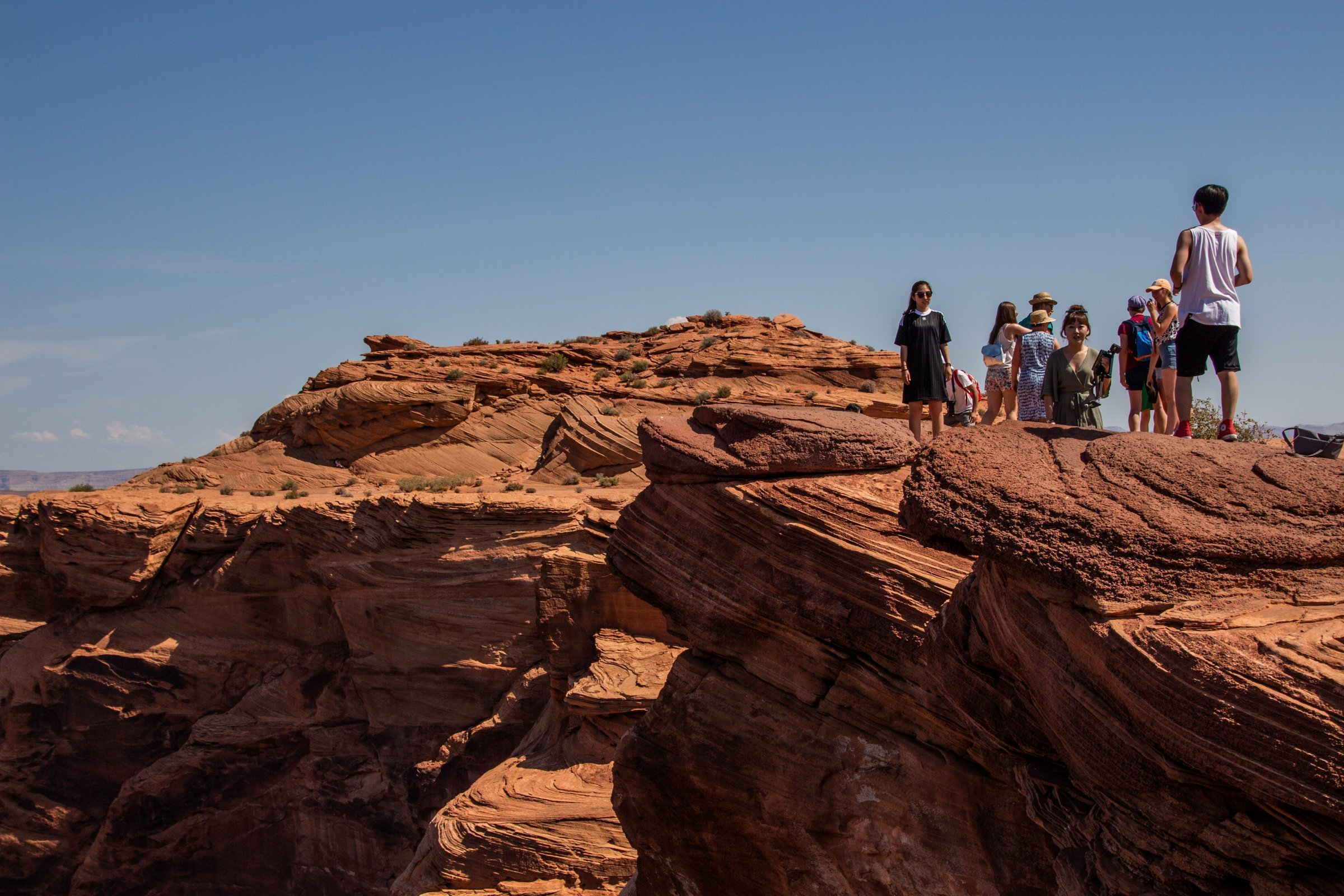 Tourists On Top Of Rock Formations