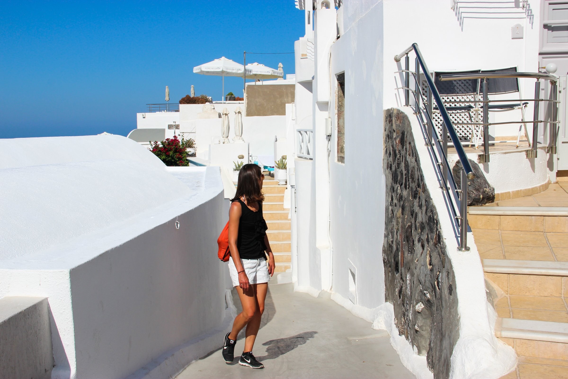 Woman In Alley In Santorini Island