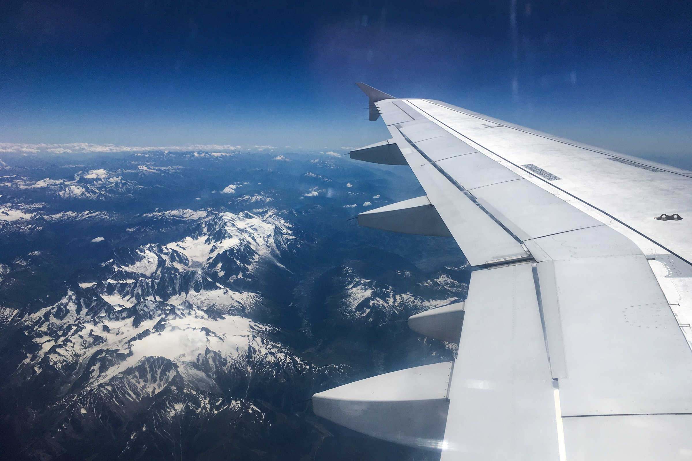 Airplane Wing Over Mountains