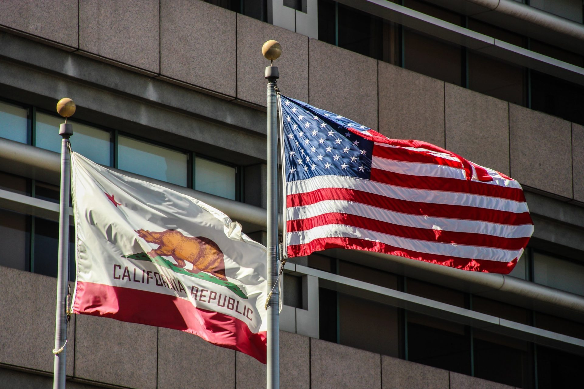 American And California State Flags On Poles