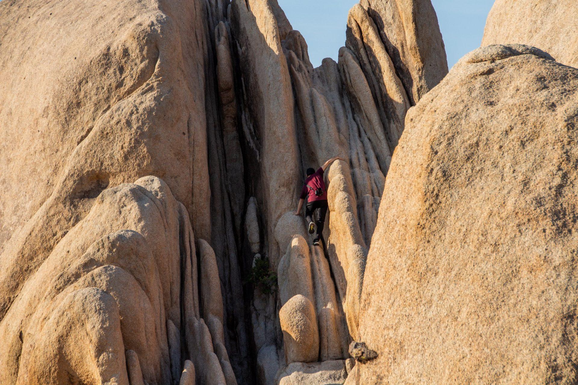 Man Climbing Big Rock