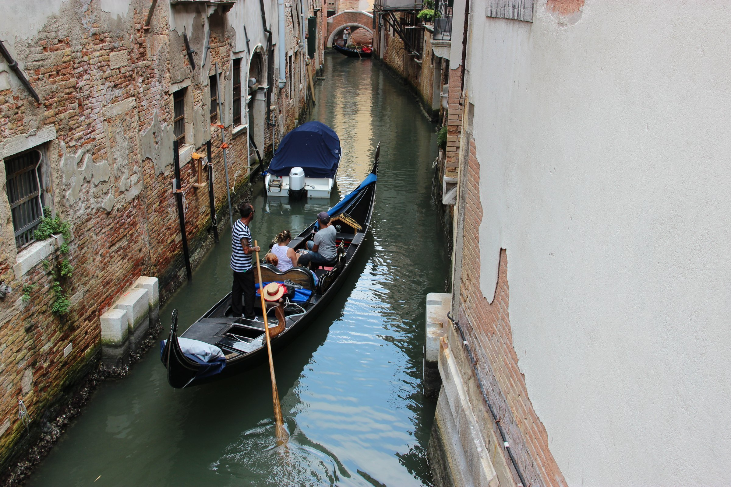 Tourists In Gondola In Venice Canal