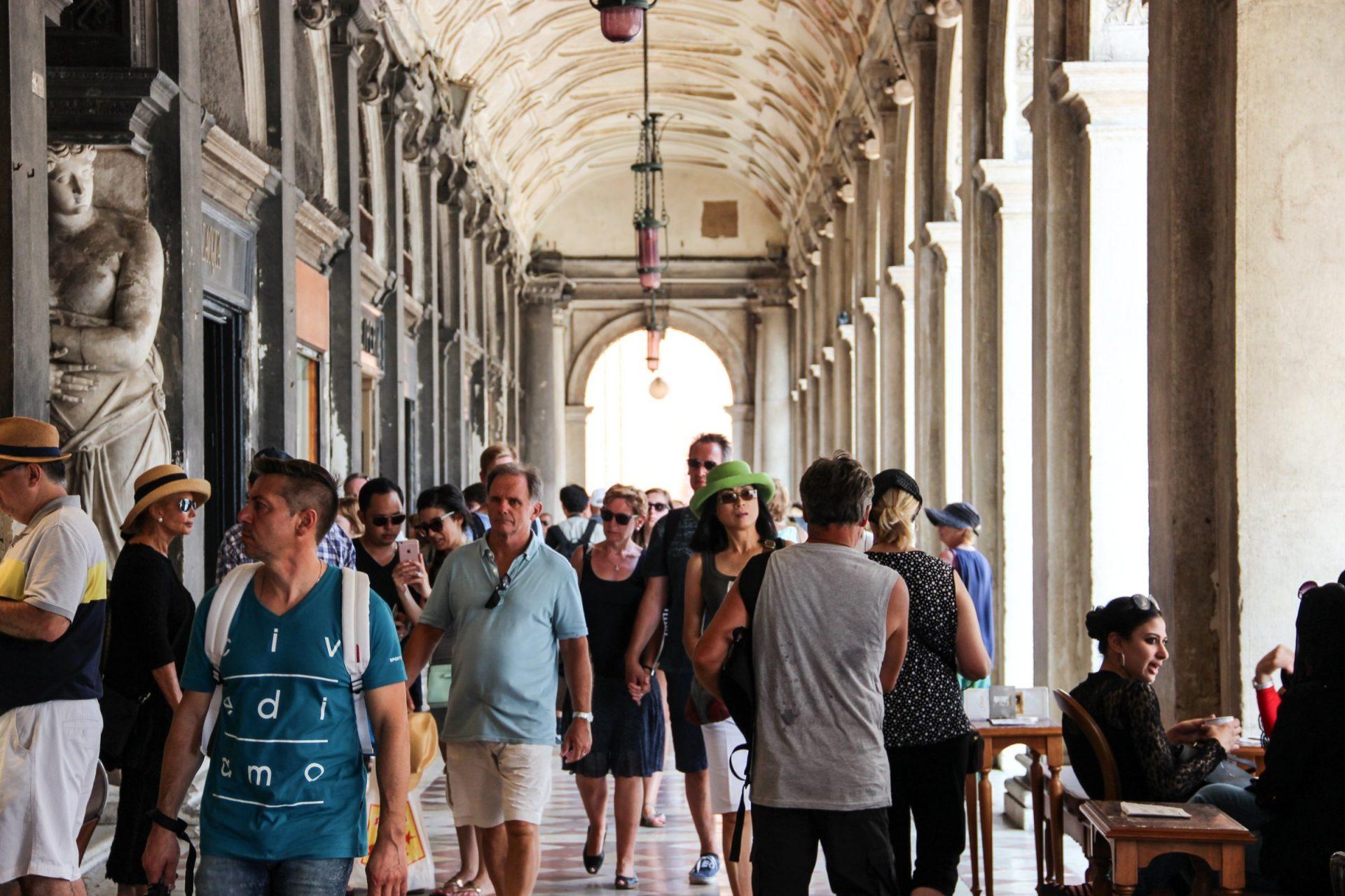 Tourists Under Arcades