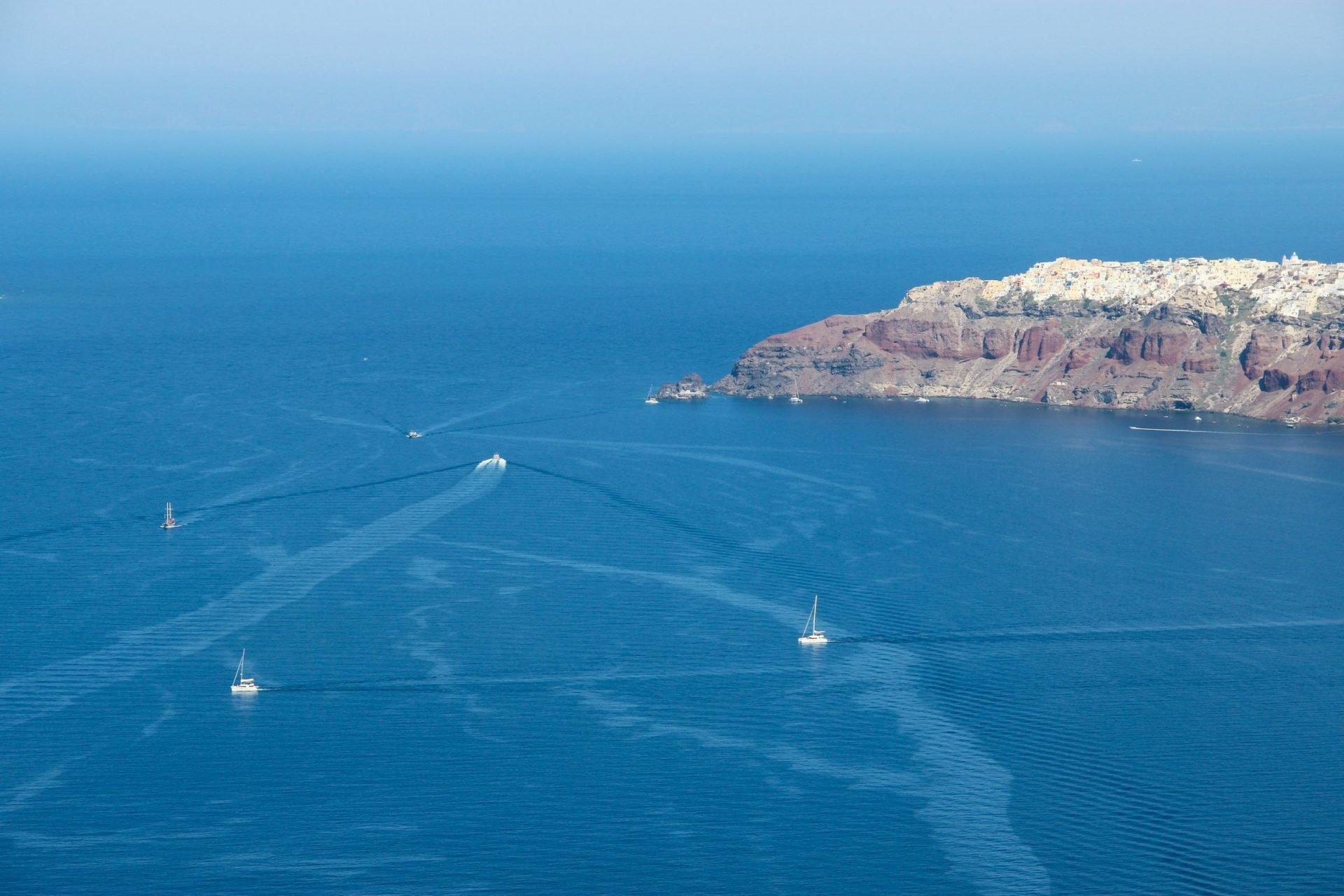Various Boats Near Santorini Shore