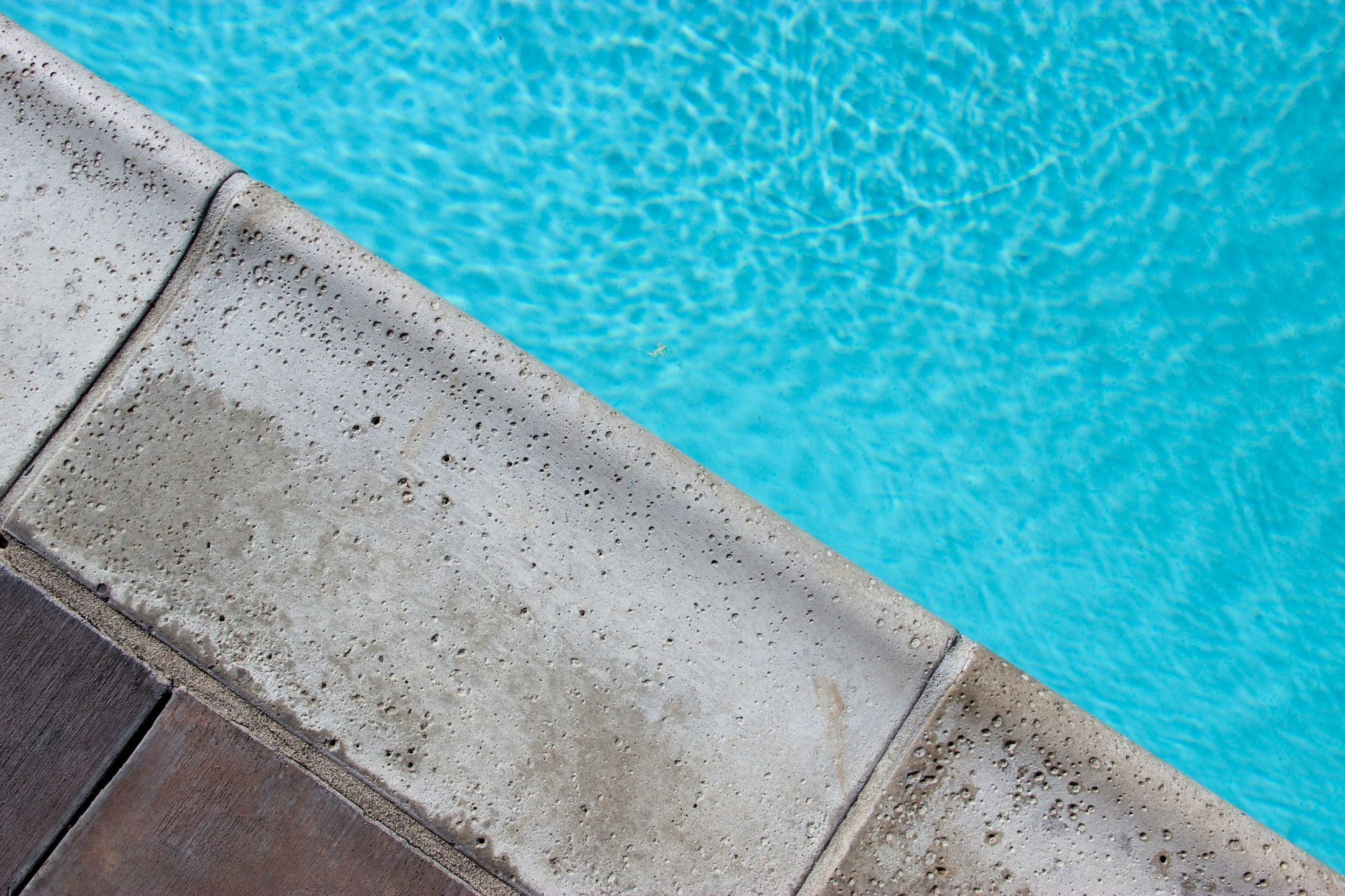 Concrete Edge Near Pool Water