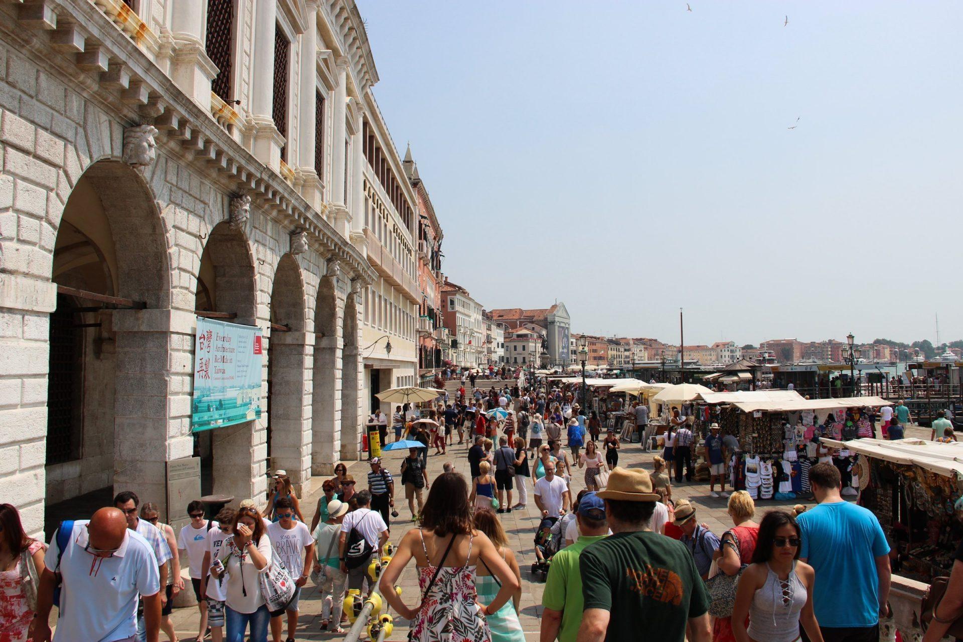 Crowds Of Tourists Near Arcade