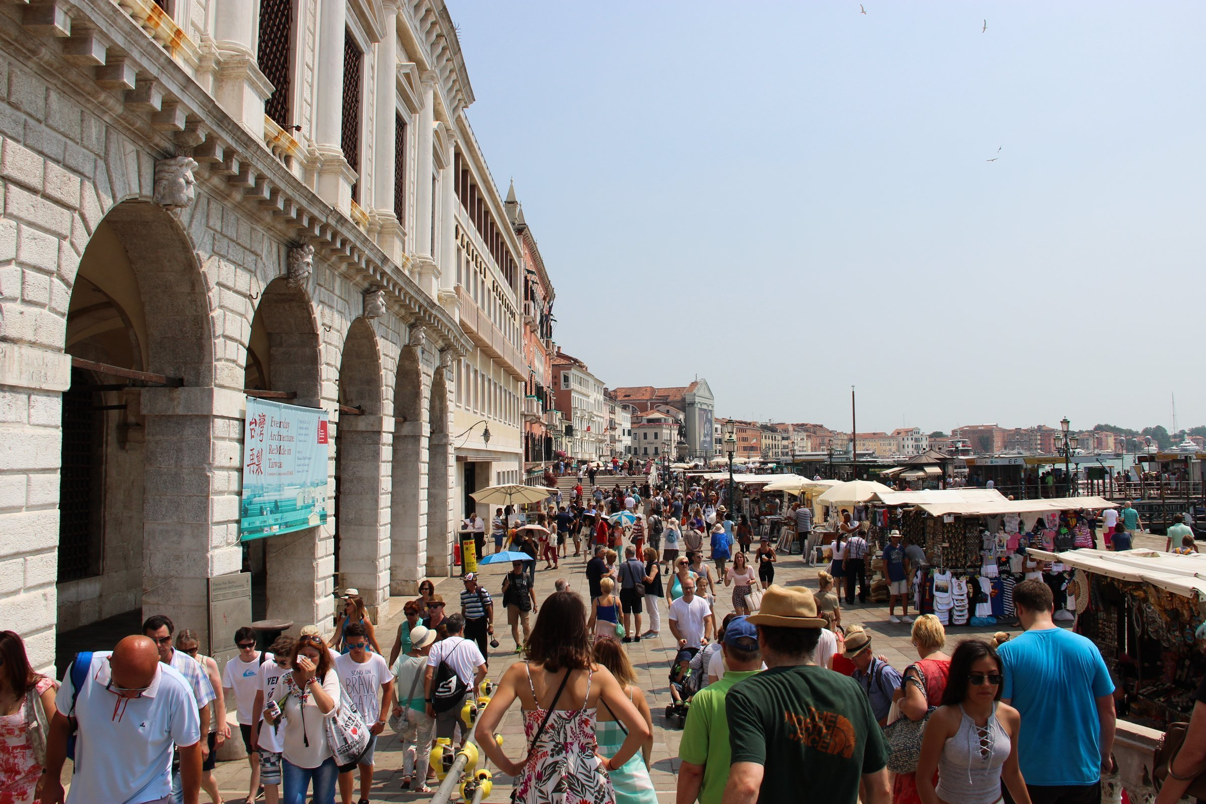 Crowds Of Tourists Near Arcade