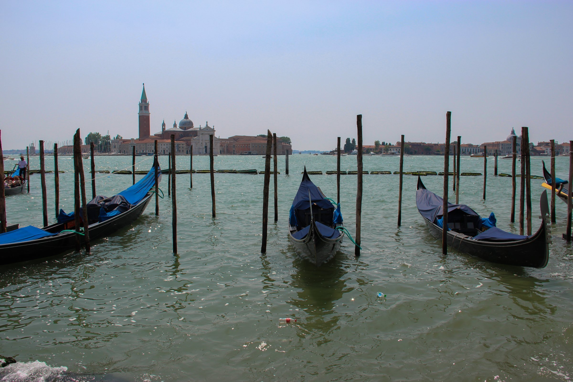 Gondolas Parked Between Wooden Poles