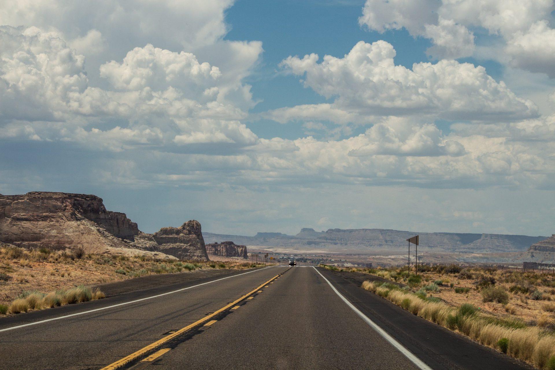 Highway In Desert Near Mountains