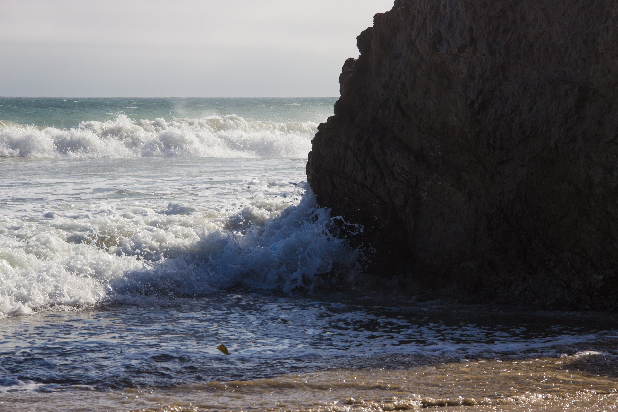 Waves Crashing On Big Rock