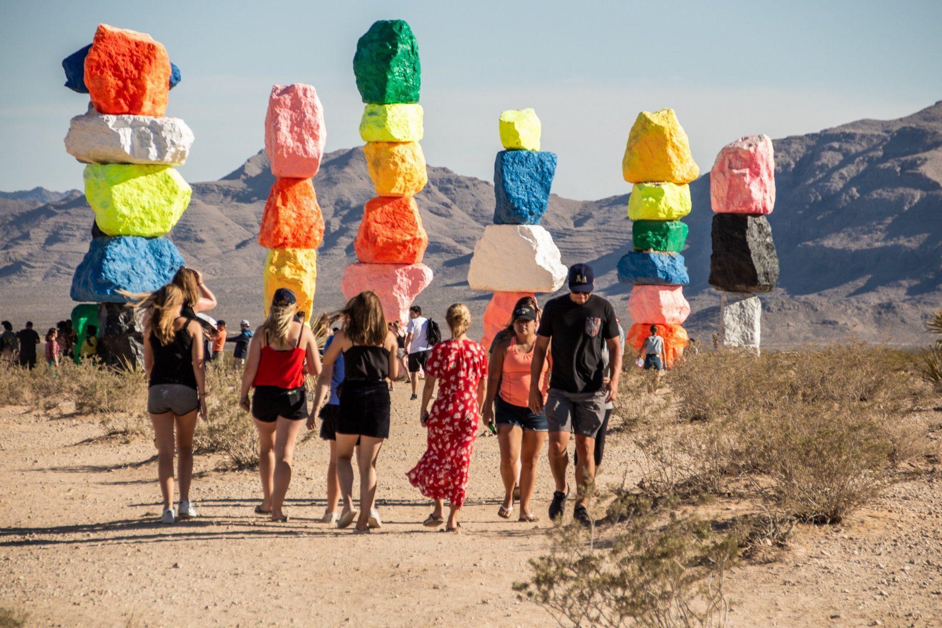 People Around Colorful Boulder Art Installation