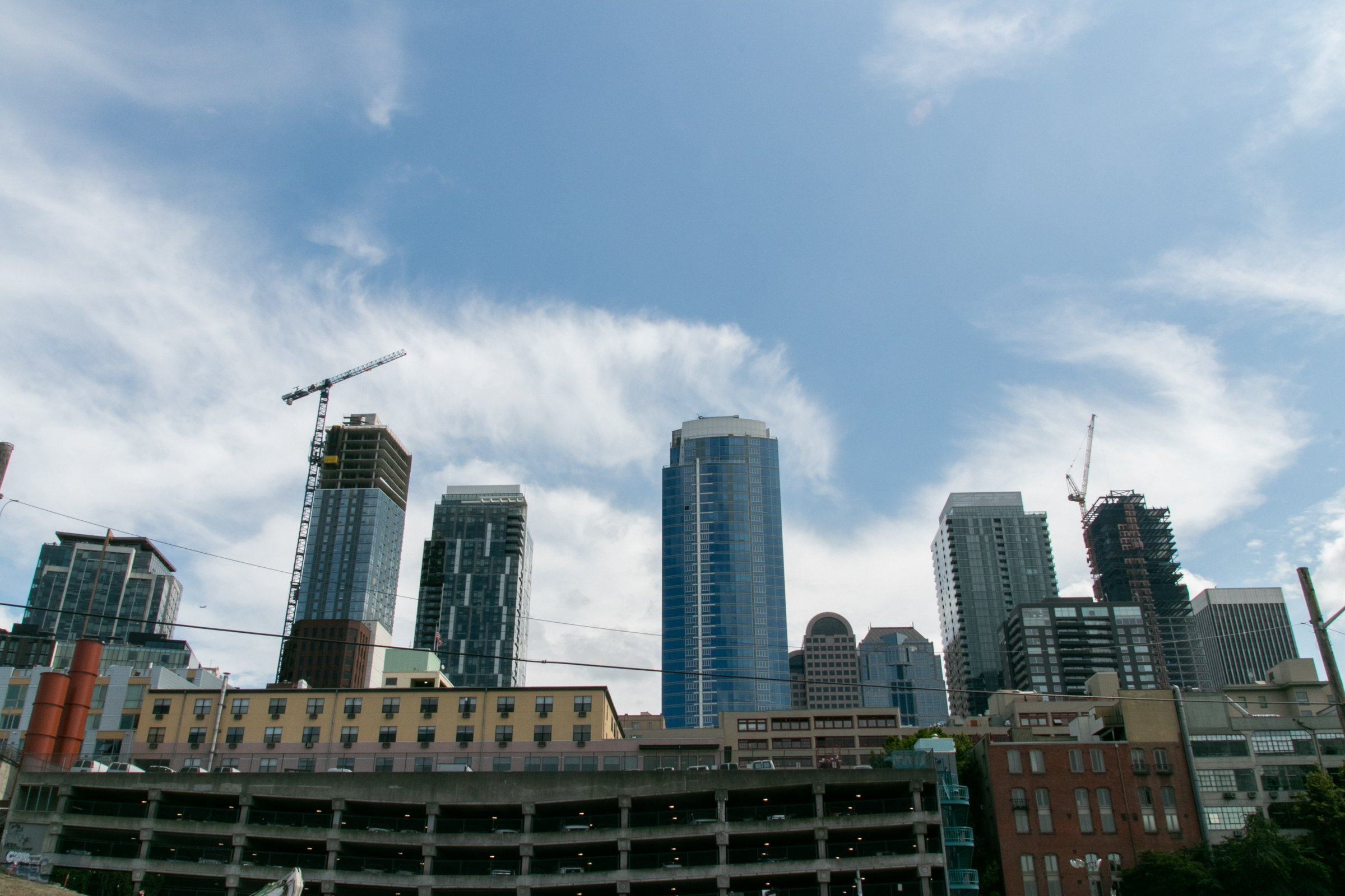 Buildings Under Construction And Tower Cranes
