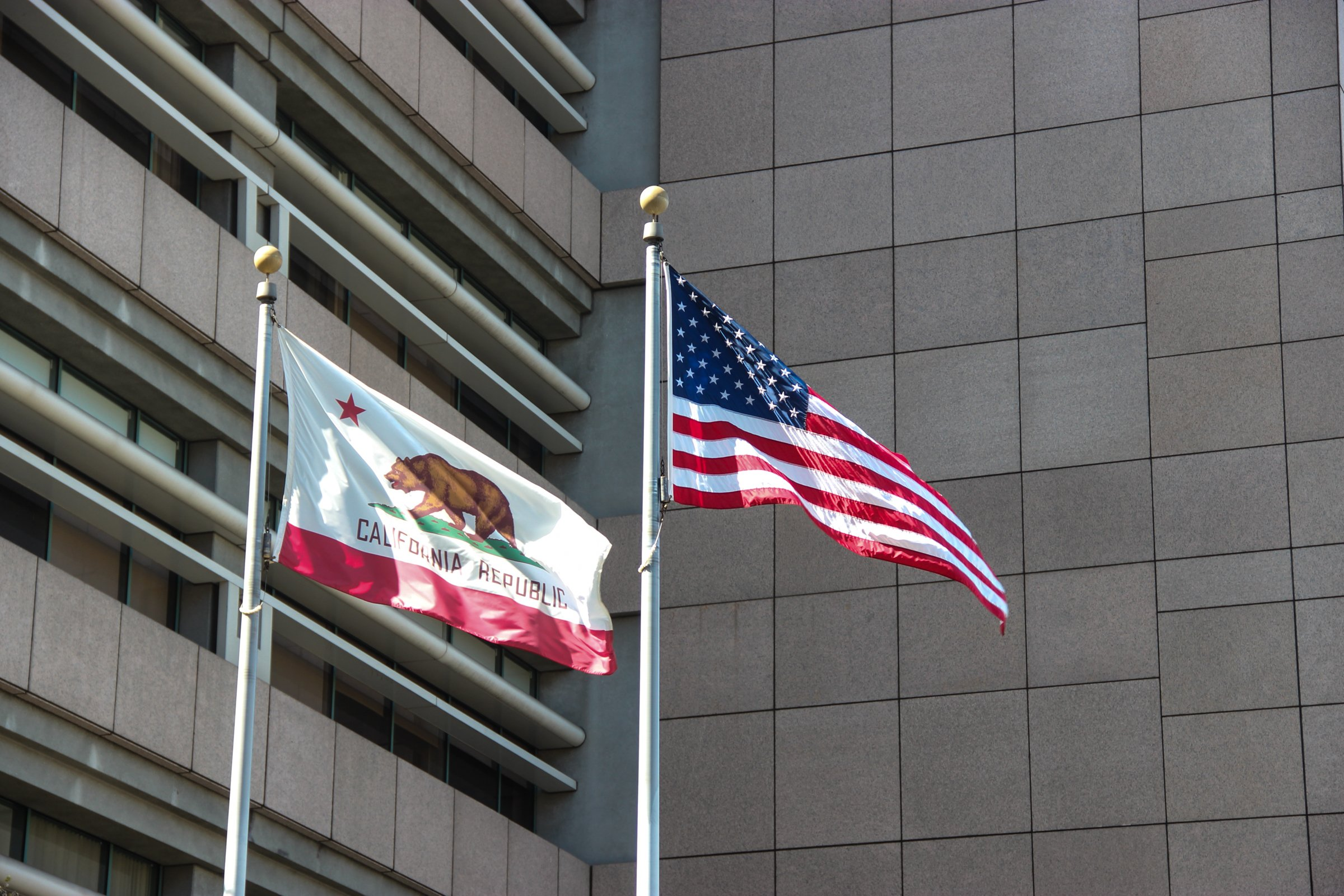 California State And American Flags Near Building