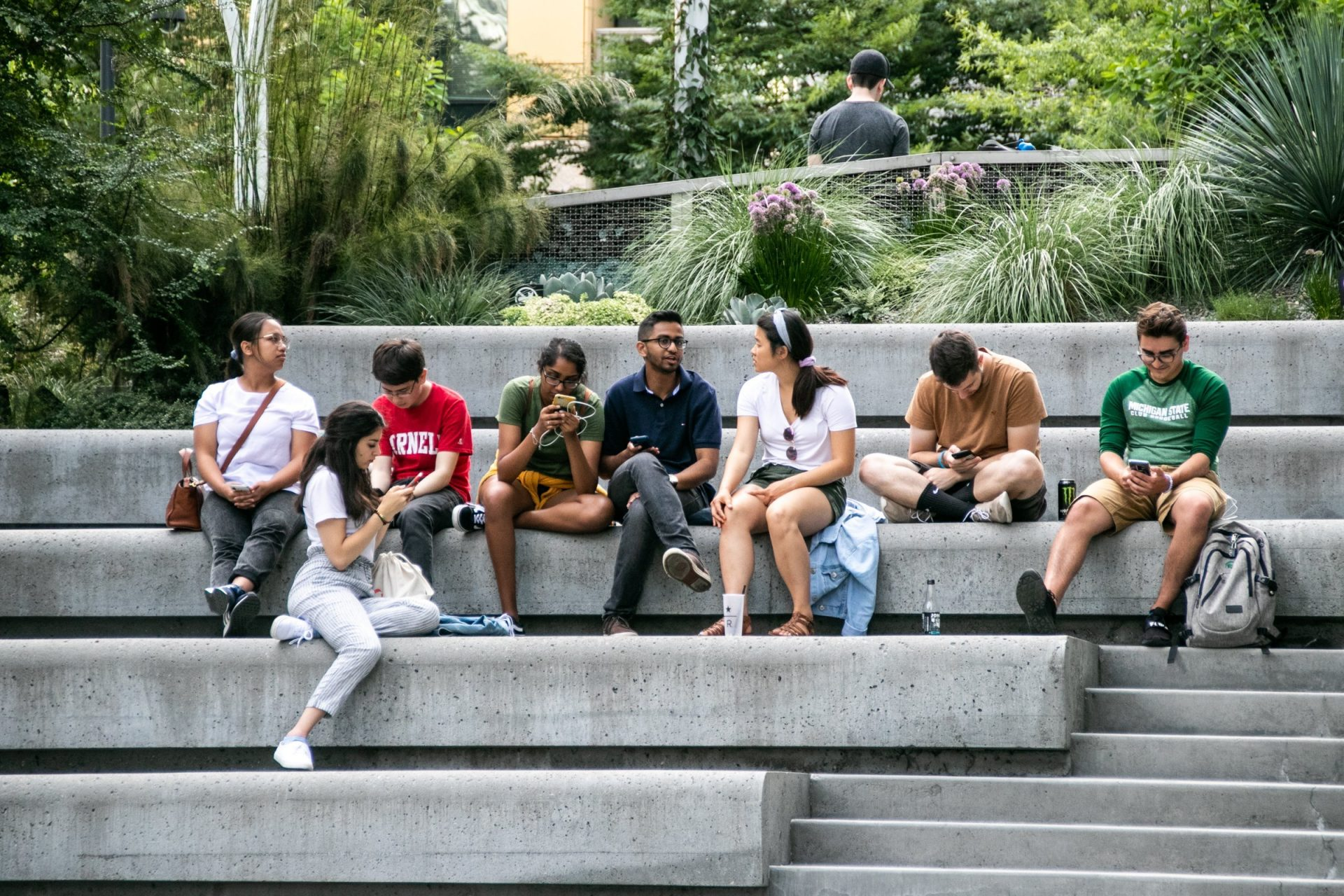 Group Of People Sitting On Concrete Steps