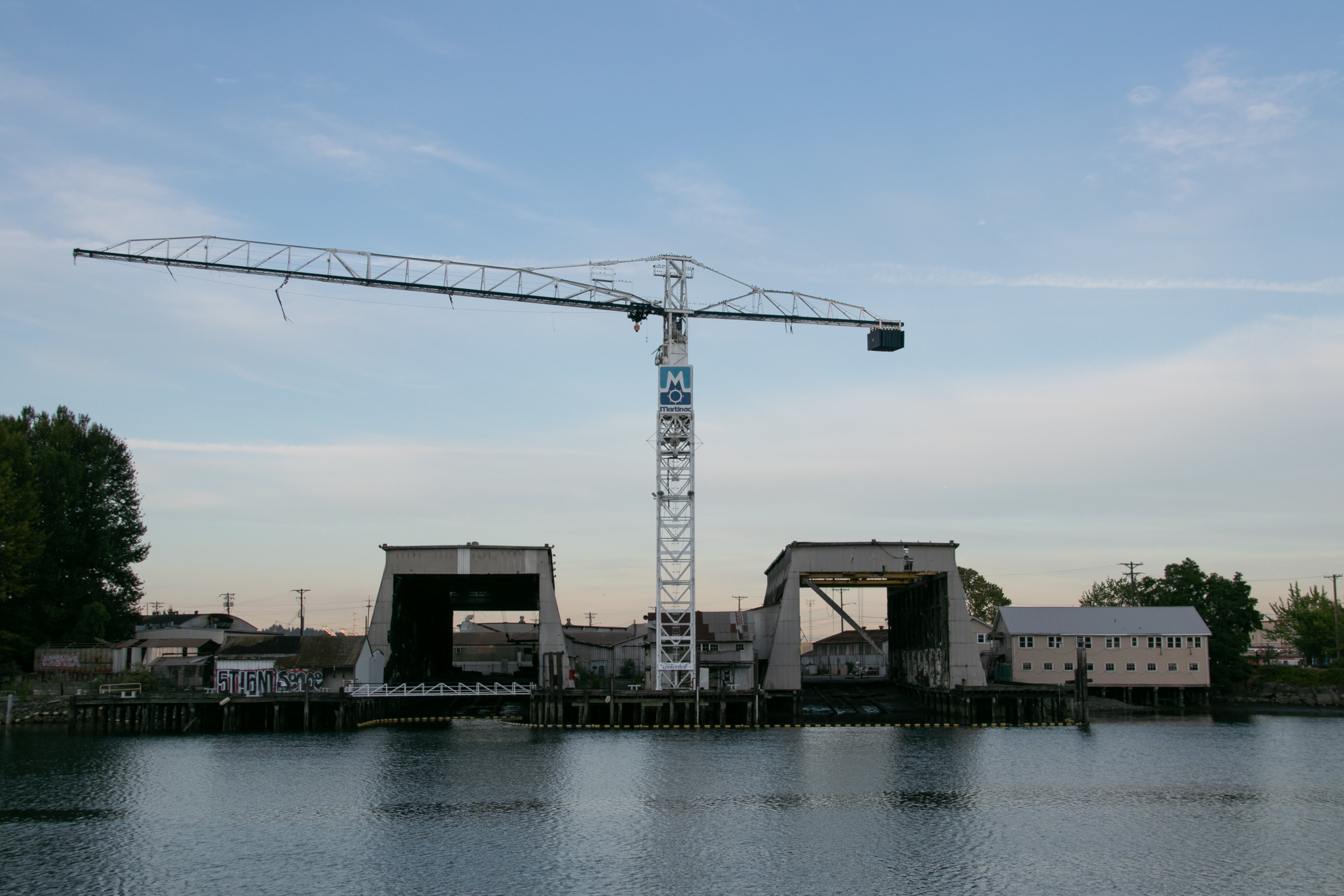 Tower Crane Between Buildings Near Water