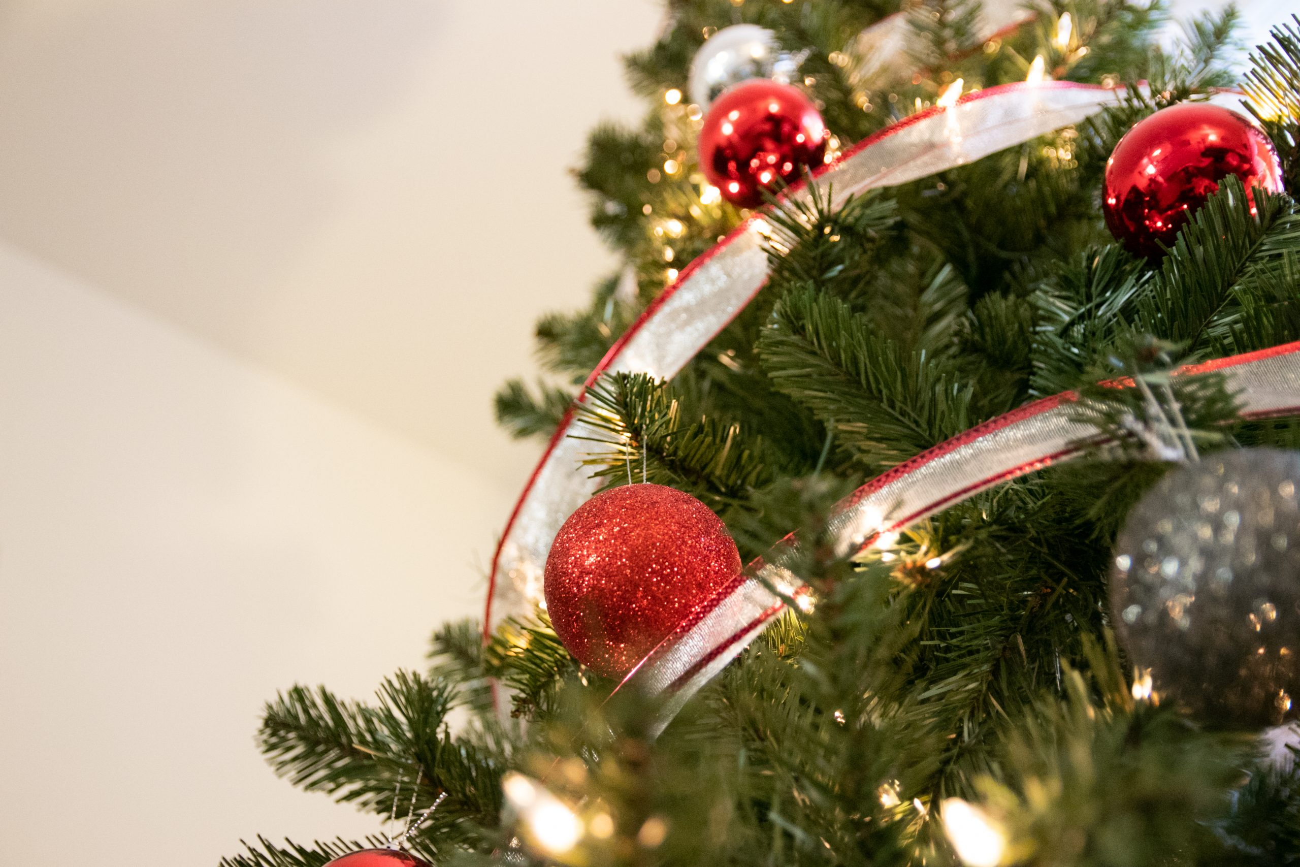 Free Stock Photo of Ornament Decorations On Lit Pine Tree