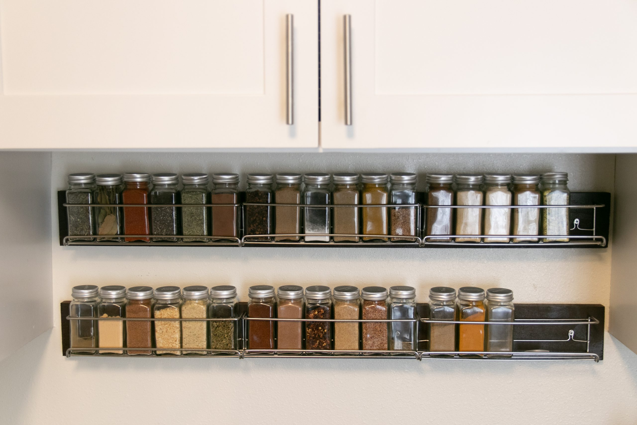 Small Jars Of Spices On Rack Organizer