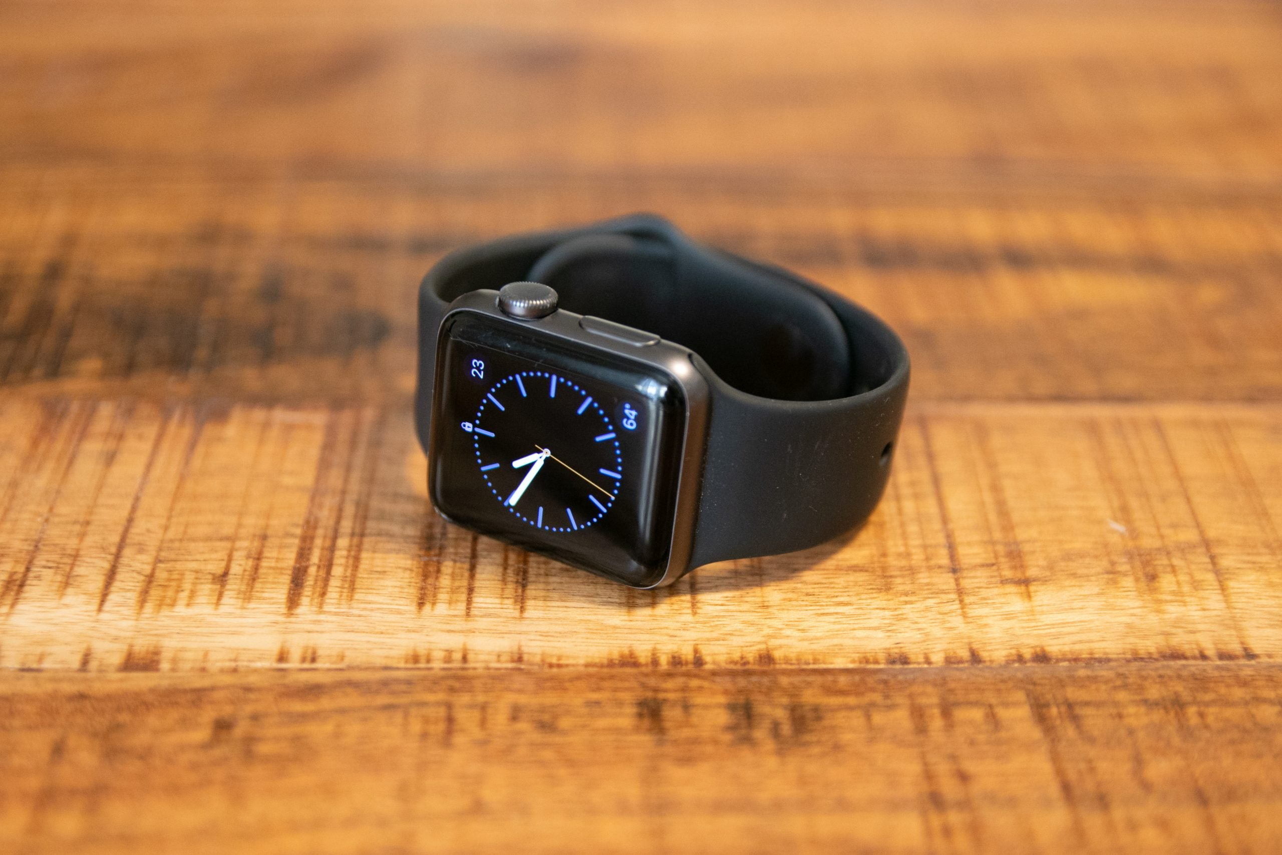 Smart Watch On Wooden Surface