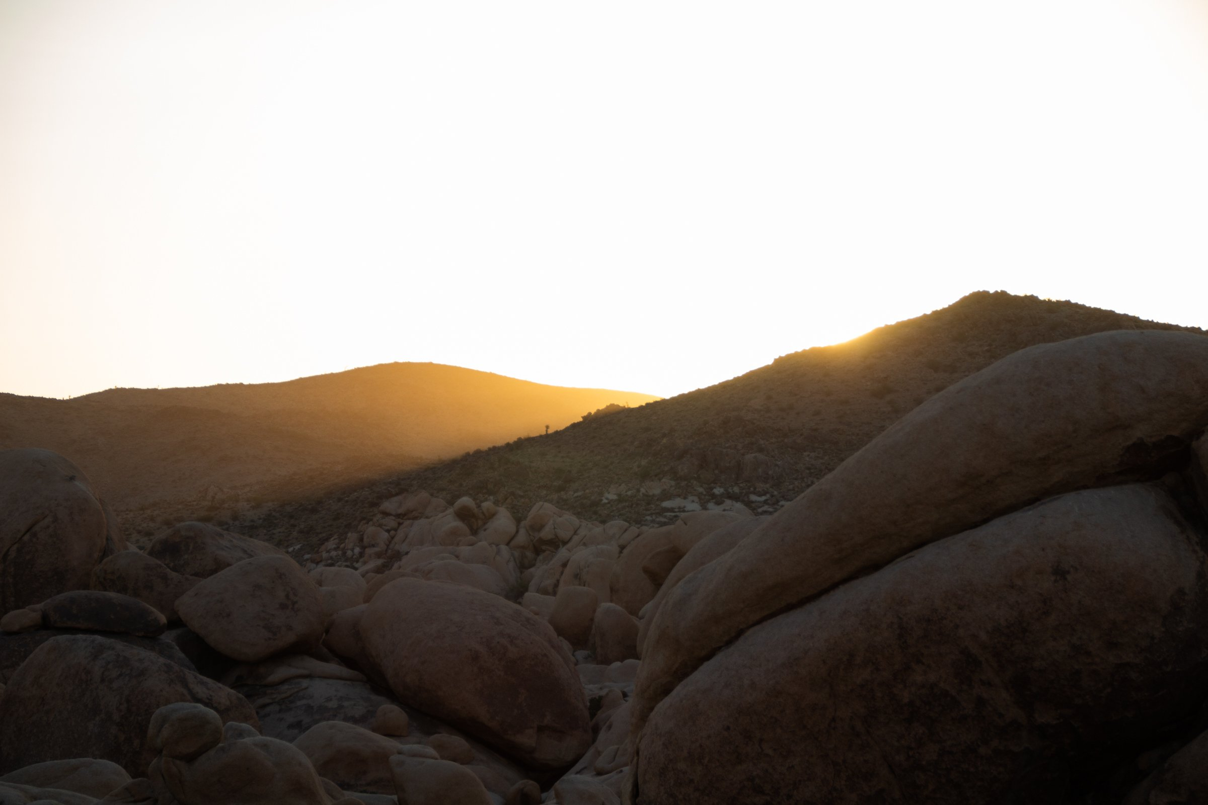 Sunset Behind Hills Near Rocks And Boulders