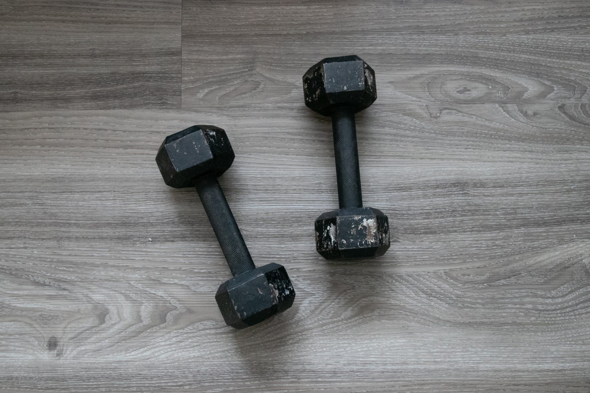 Cast Iron Dumbbells On Wooden Surface