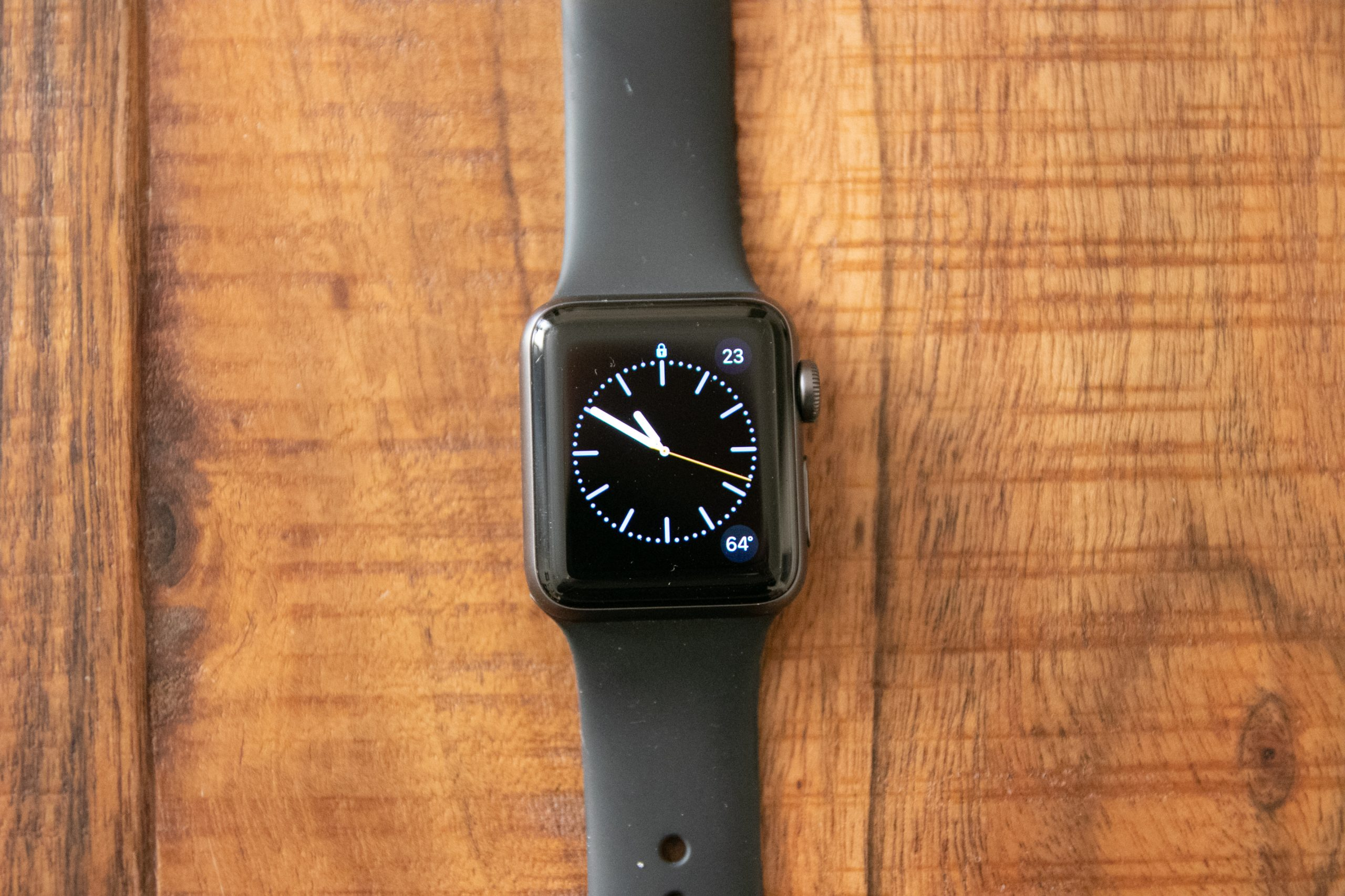 Dark Strapped Smart Watch On Wooden Surface