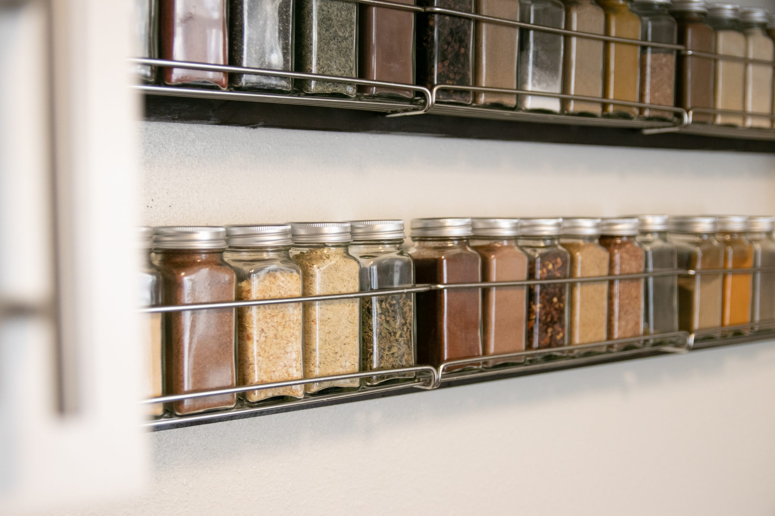 Filled Jars In Wall Mounted Spice Rack