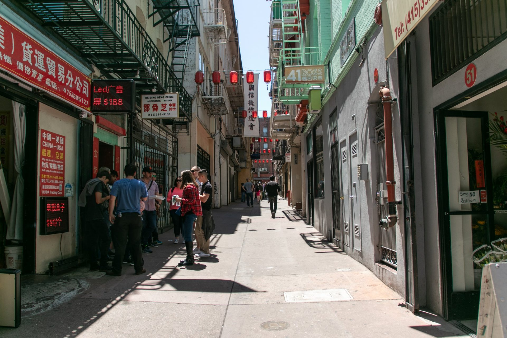 Group Of People Standing In Chinatown Street