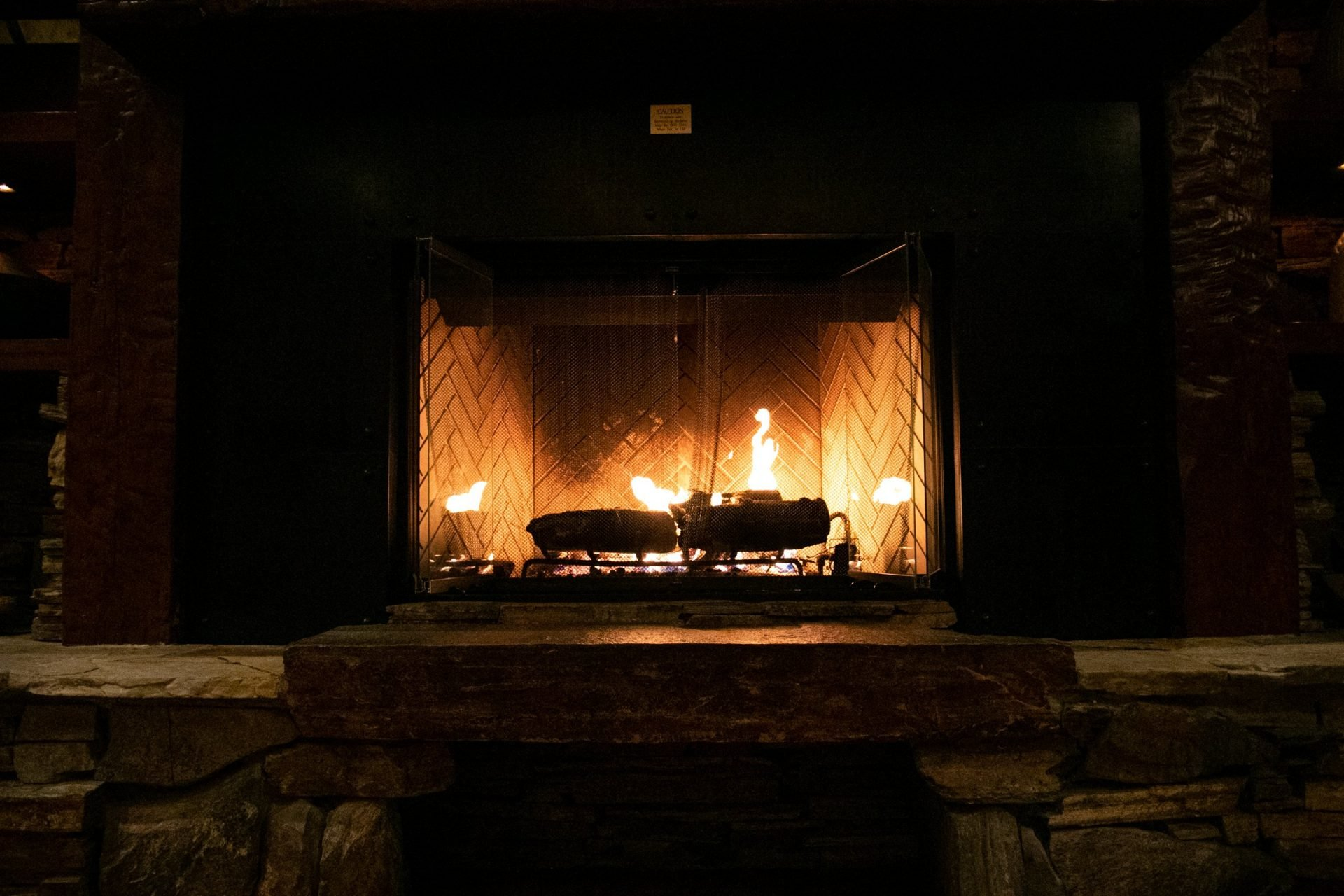 Logs Burning In Raised Hearth Fireplace