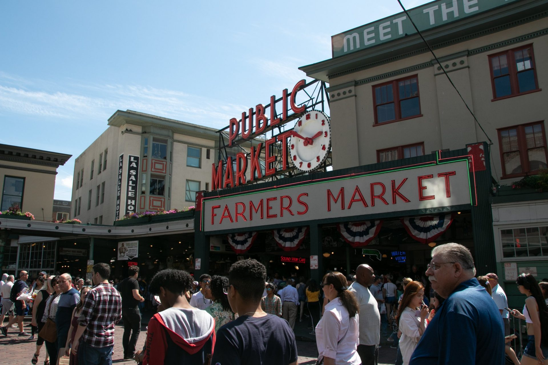 People Strolling Through Pike Place Market