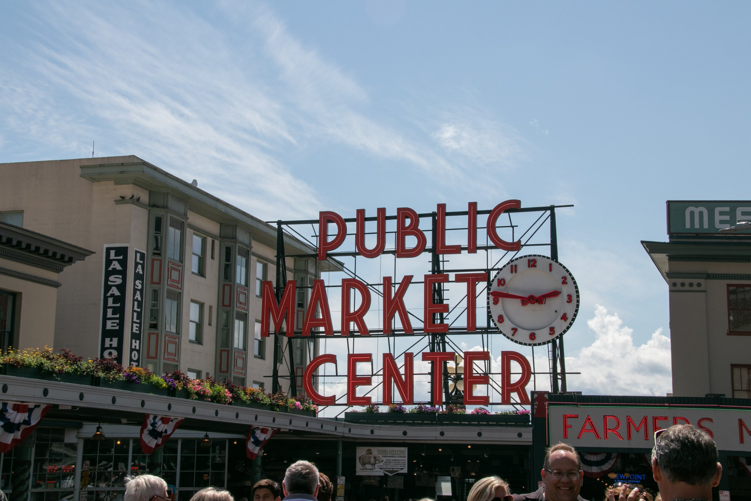 Signs And Clock In Pike Place Market