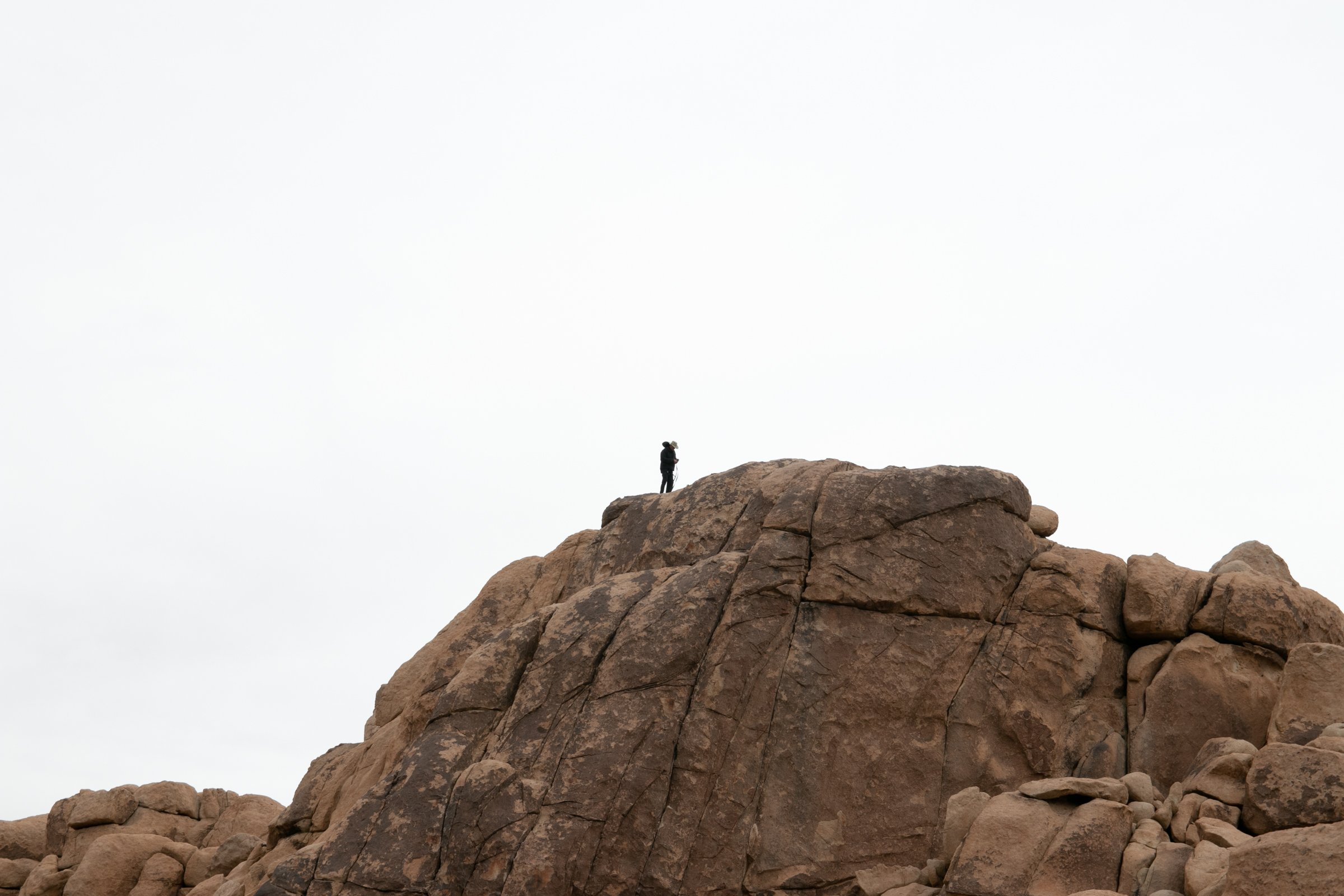 Single Man On Rock Formation