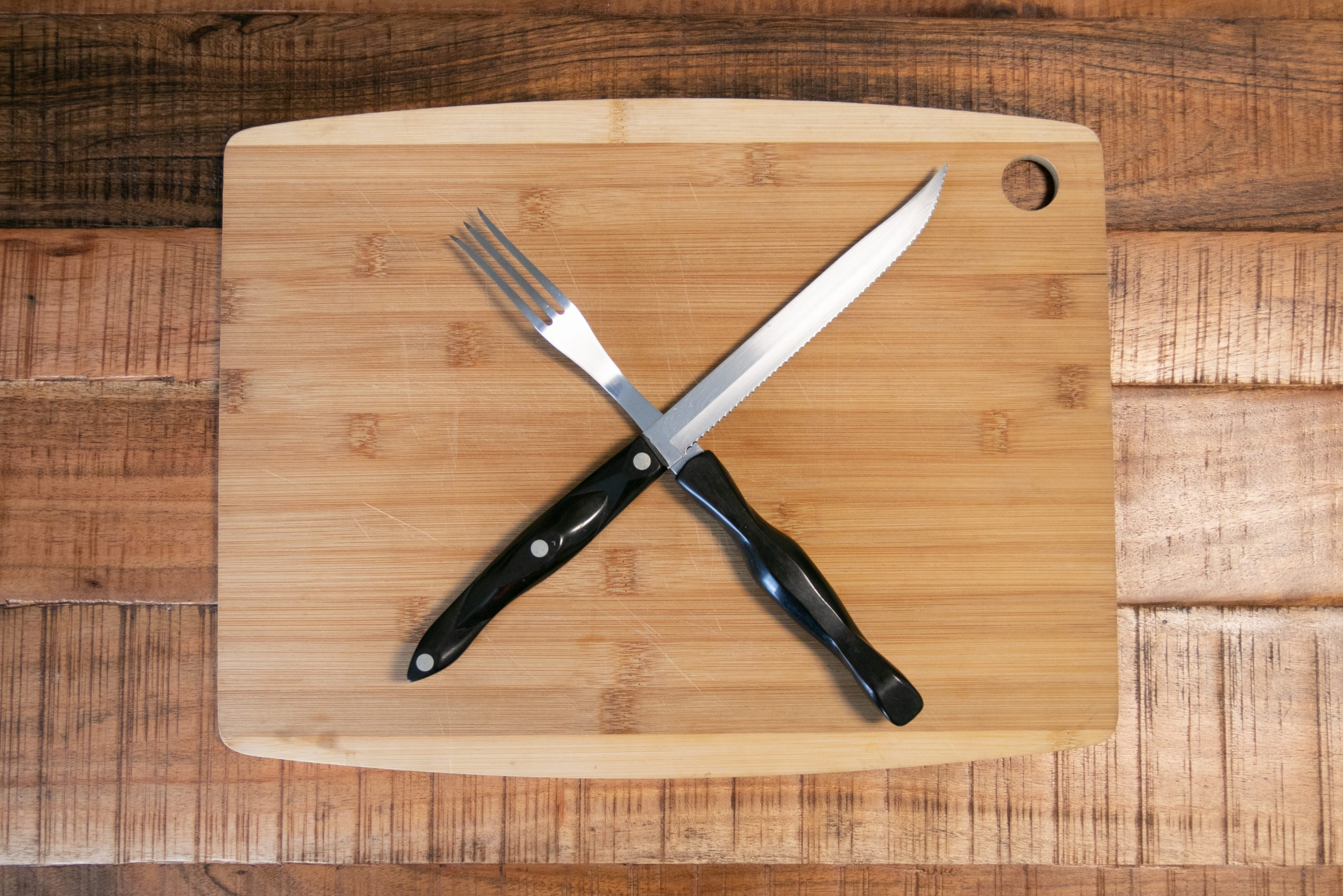 Steak Fork And Knife On Cutting Board