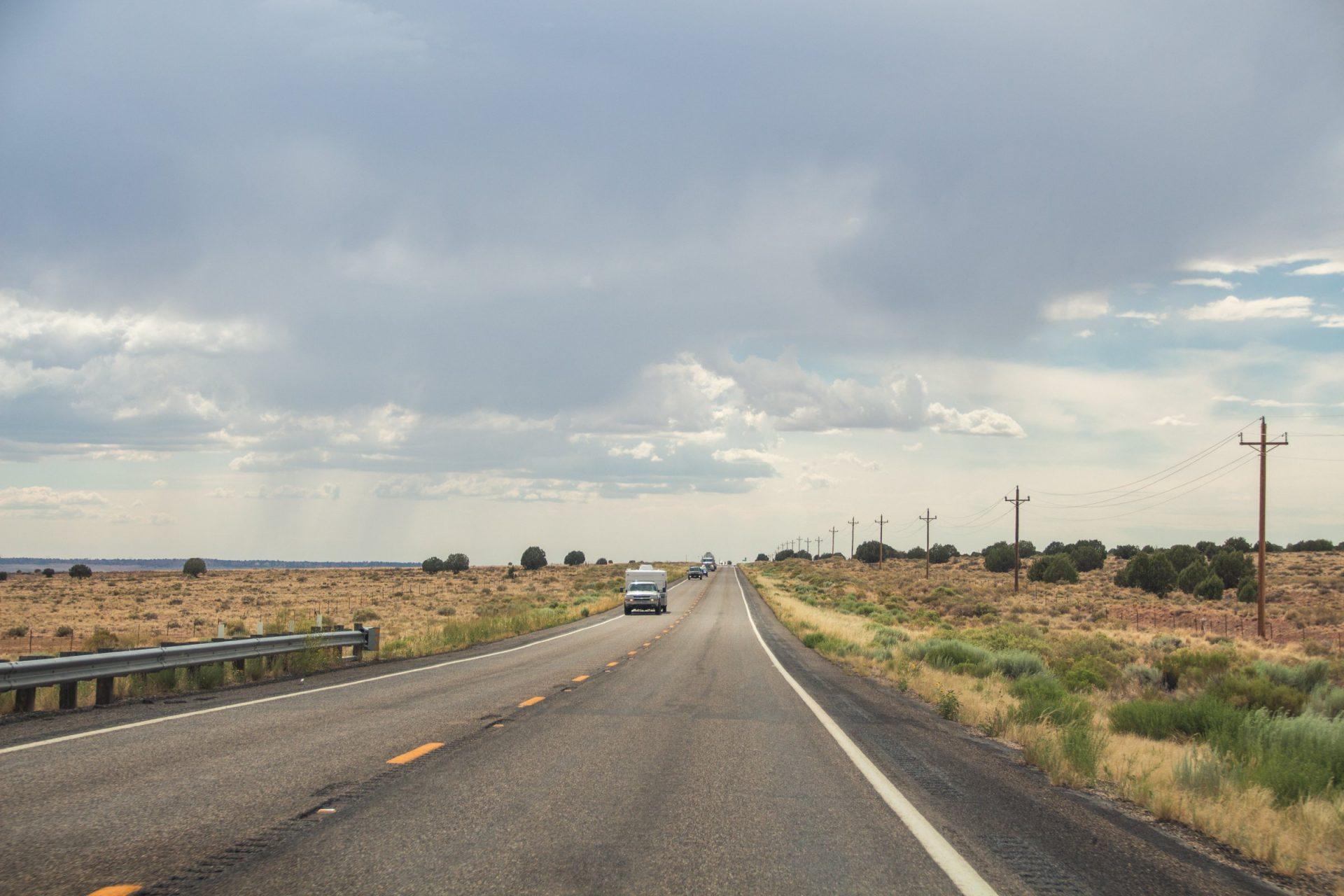 Vehicles In Two Lane Desert Road