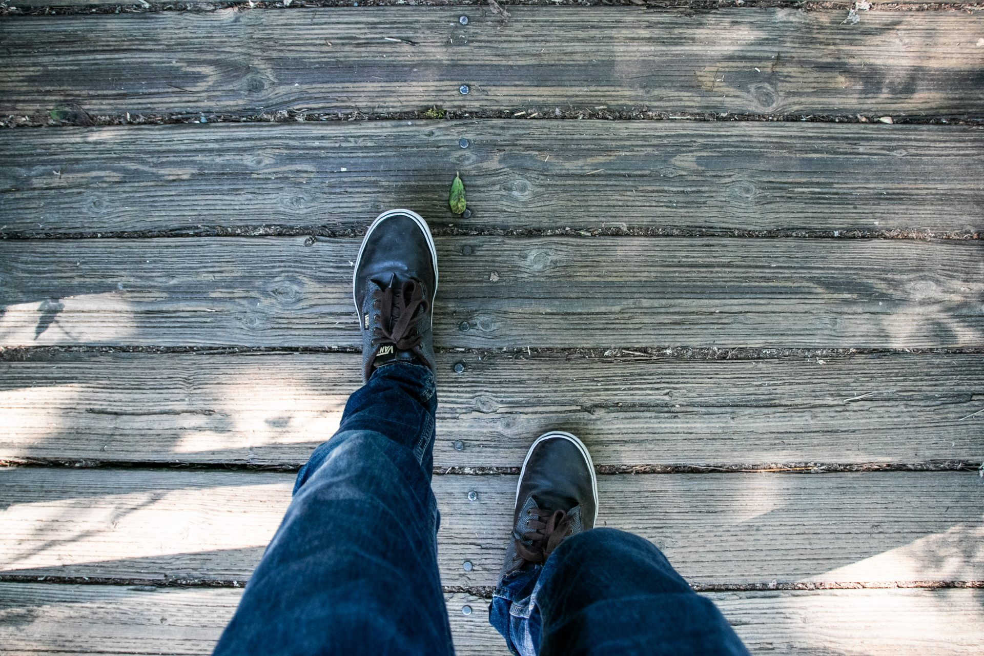Walking Human Legs On Wooden Boardwalk