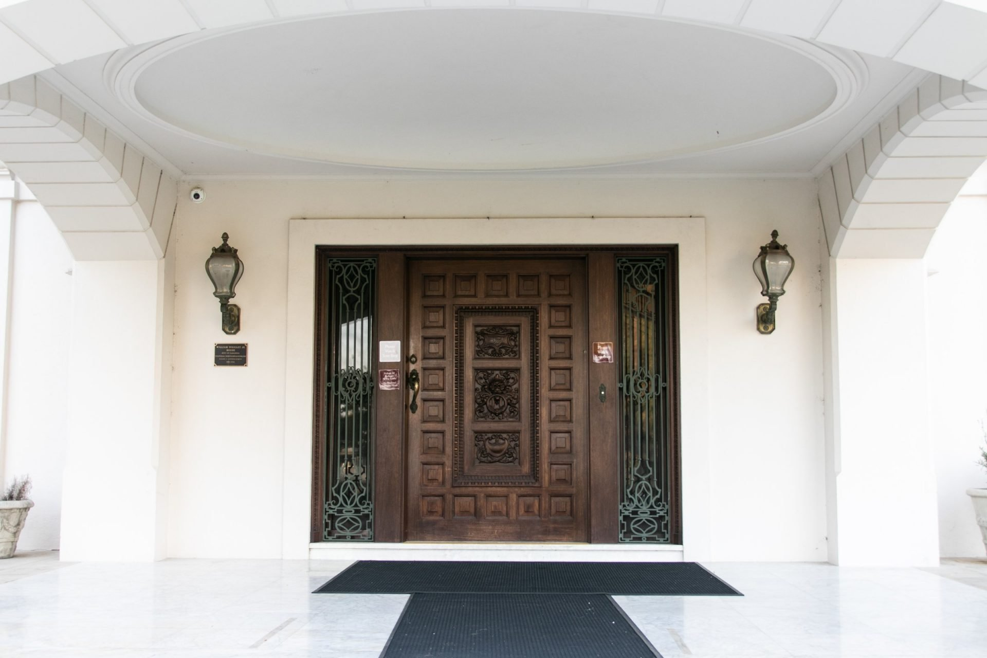 Mahogany Front Door Of White Historic Mansion
