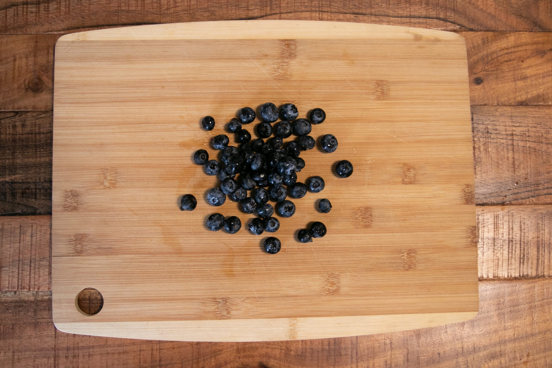 Blueberries On Wooden Cutting Board