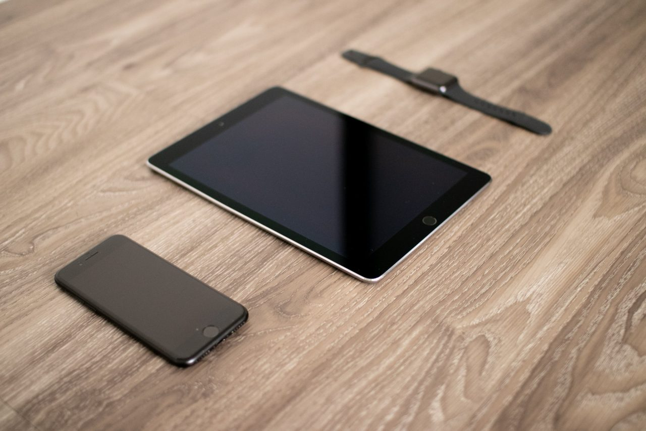 Apple Tech Products On Wooden Surface