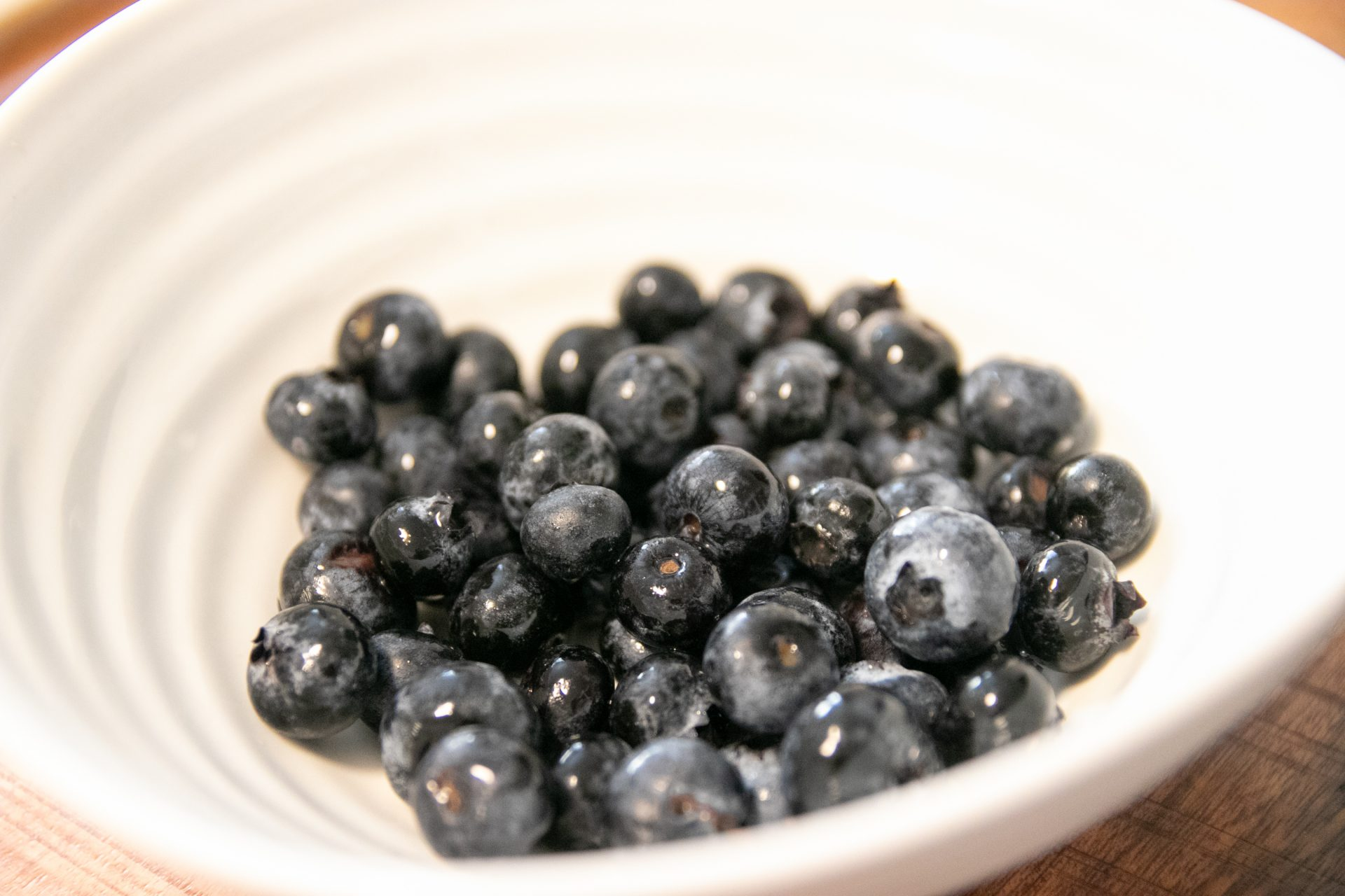 Close Up Of Blueberries In White Bowl