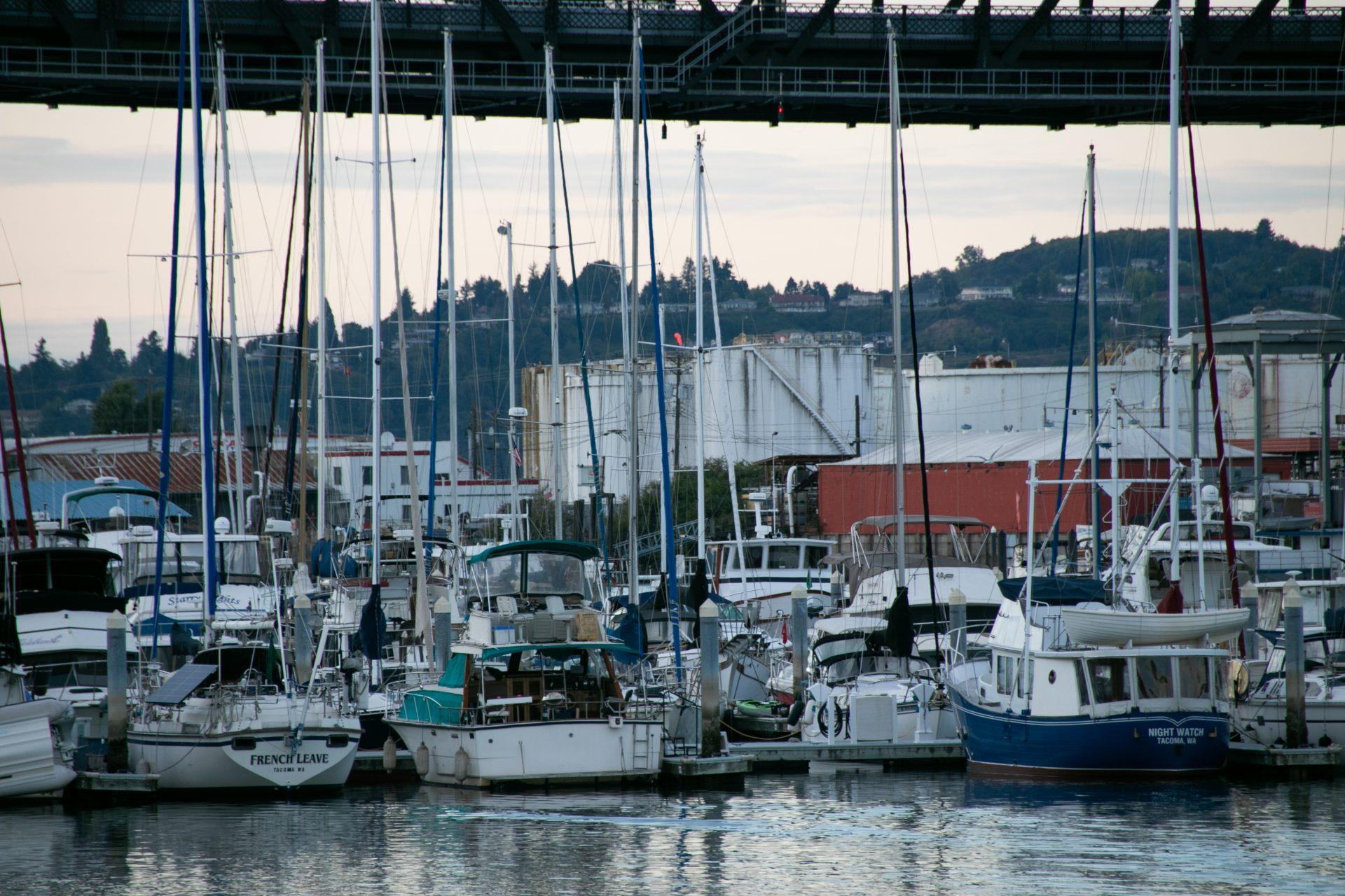 Moored Boats To Pier Near Bridge