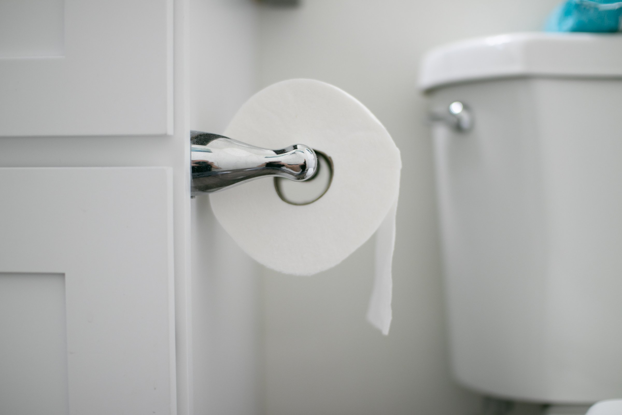 Paper Roll On Holder Next To Toilet