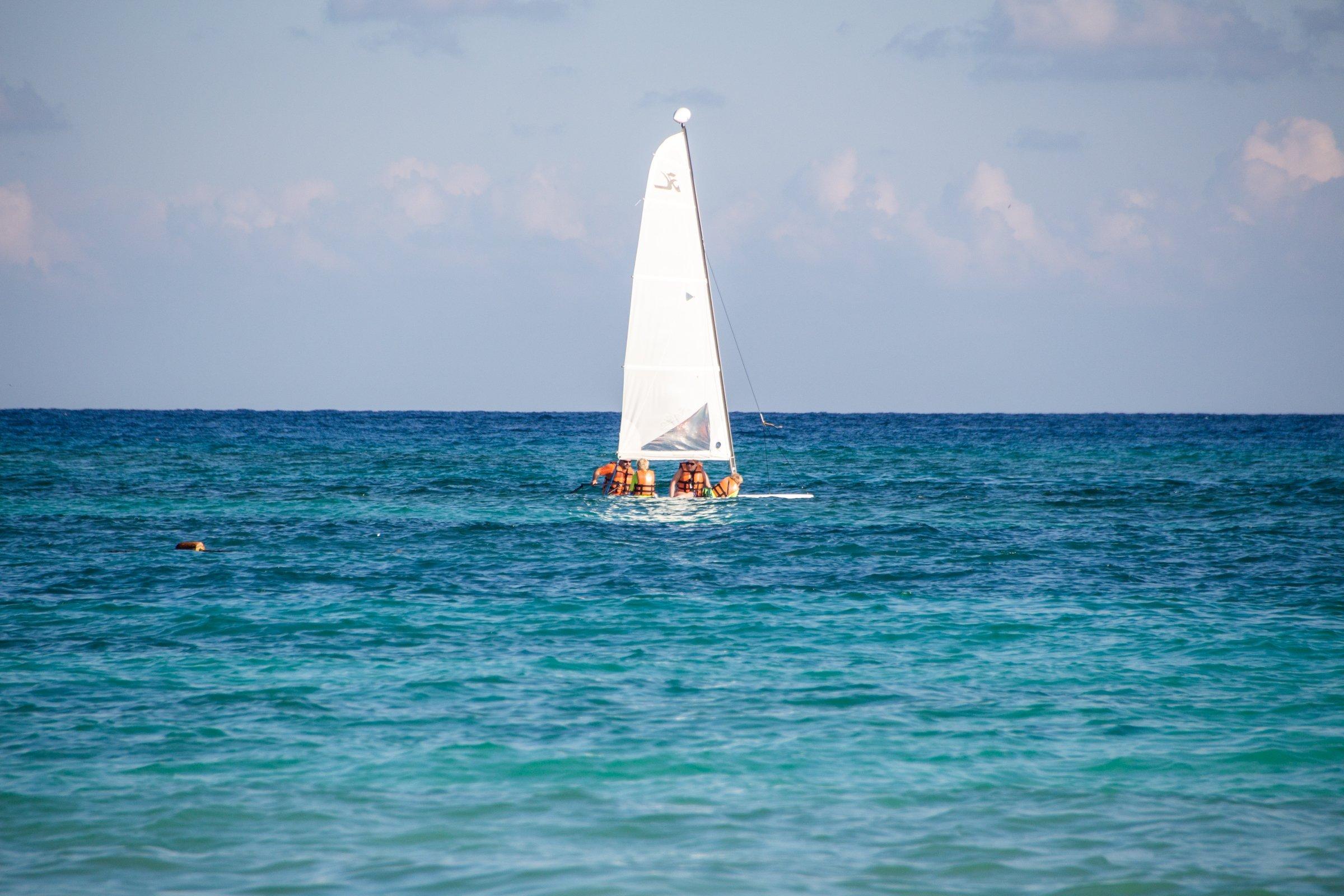 People On Longboard Windsurfer On Water