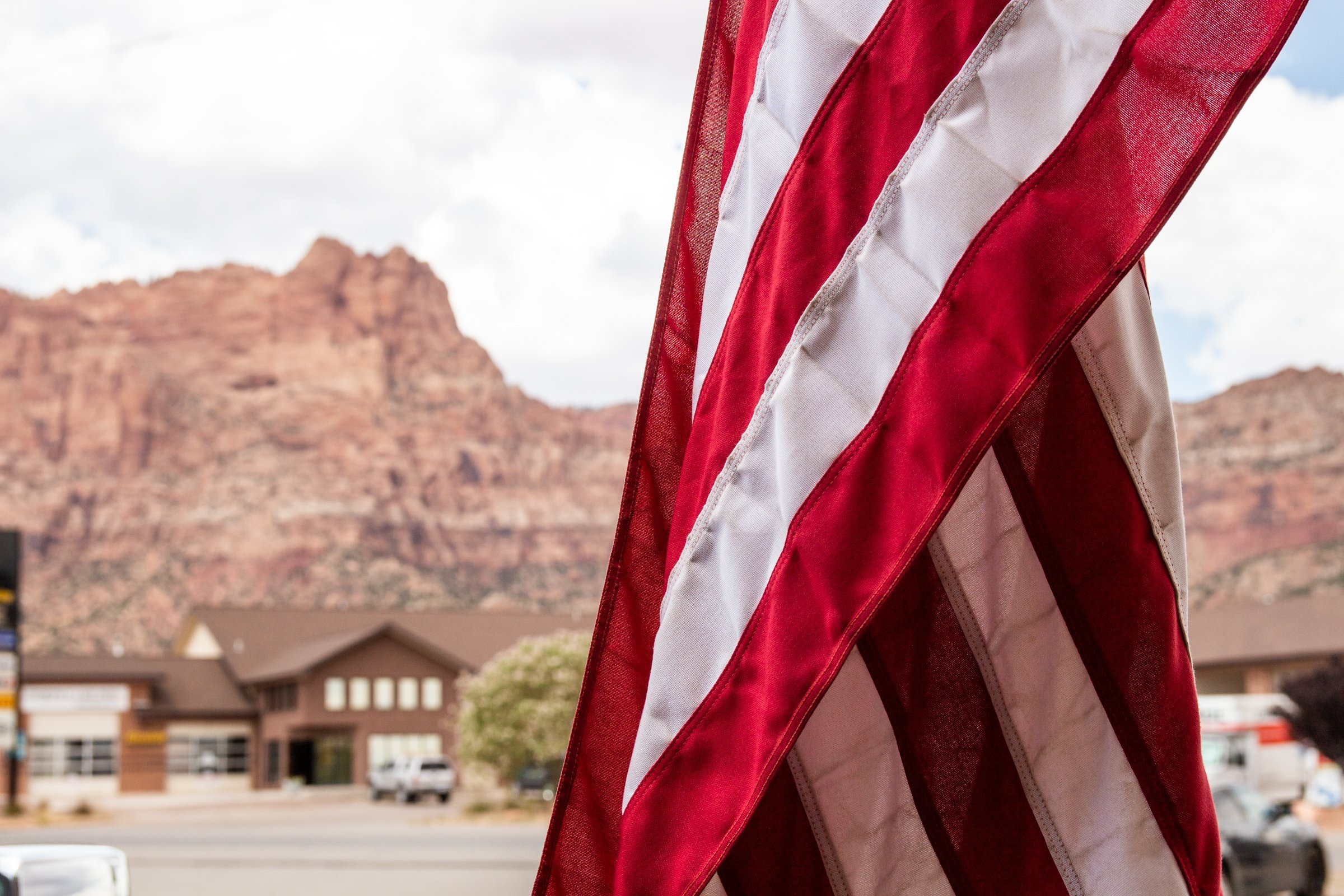 Stripes Of American Flag Against Mountains