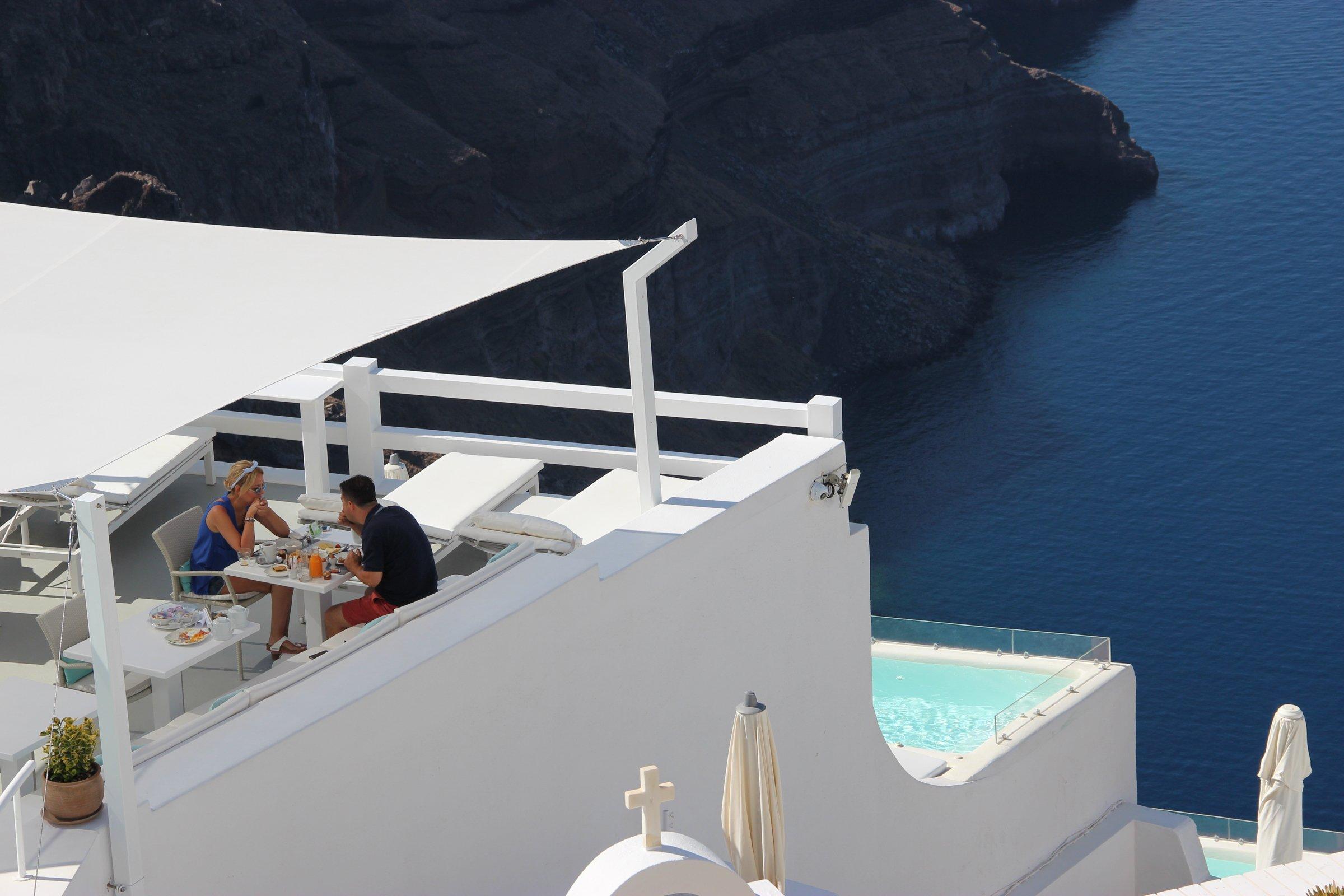 Two People In Restaurant Terrace Overlooking Water