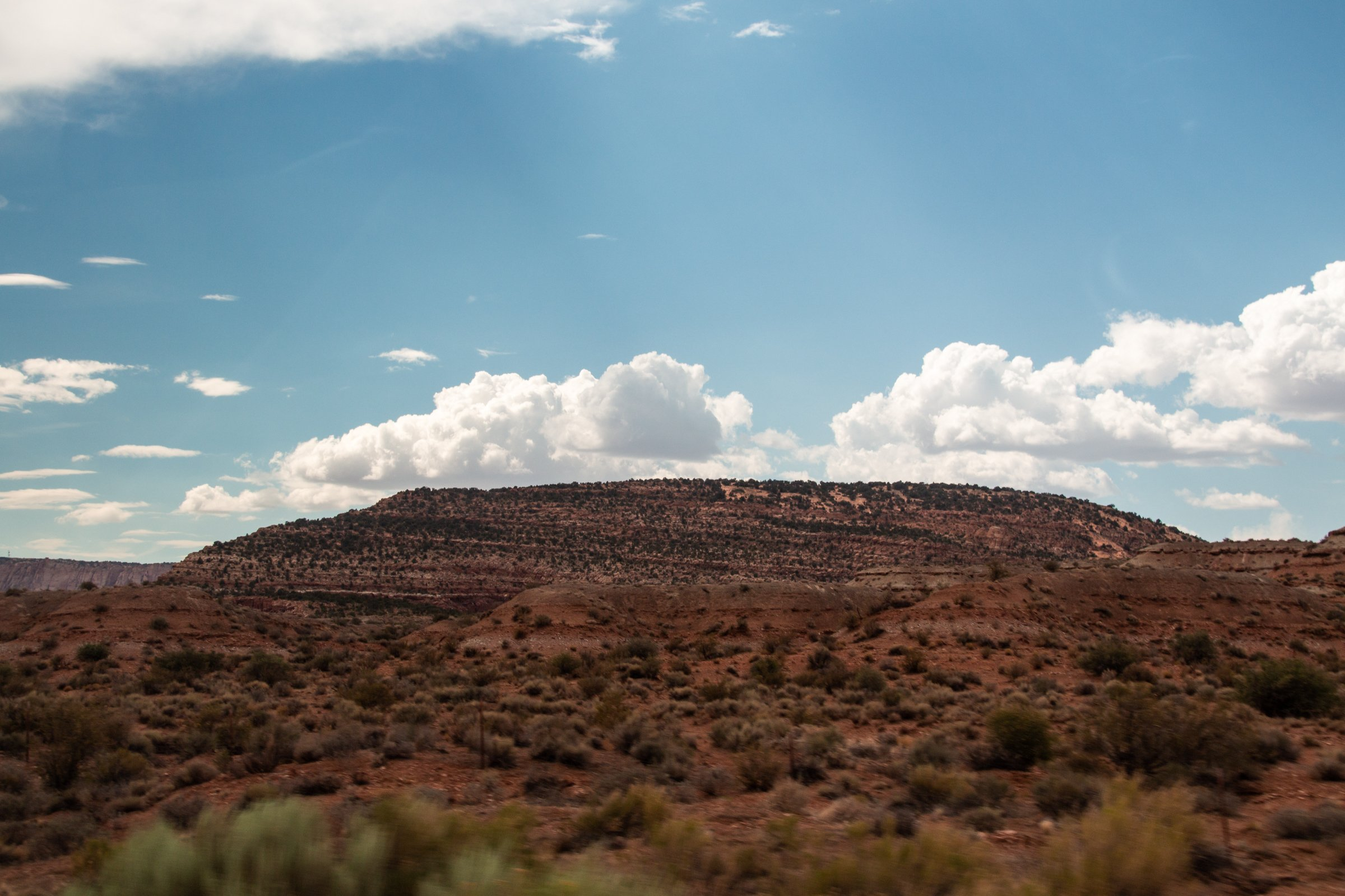 White Clouds Above Mountain In Desert