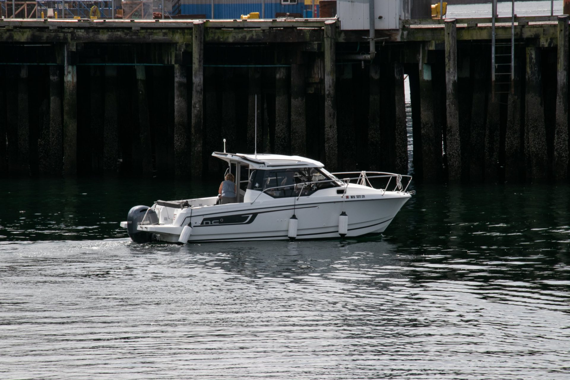 White Motorboat On Water Near Pier